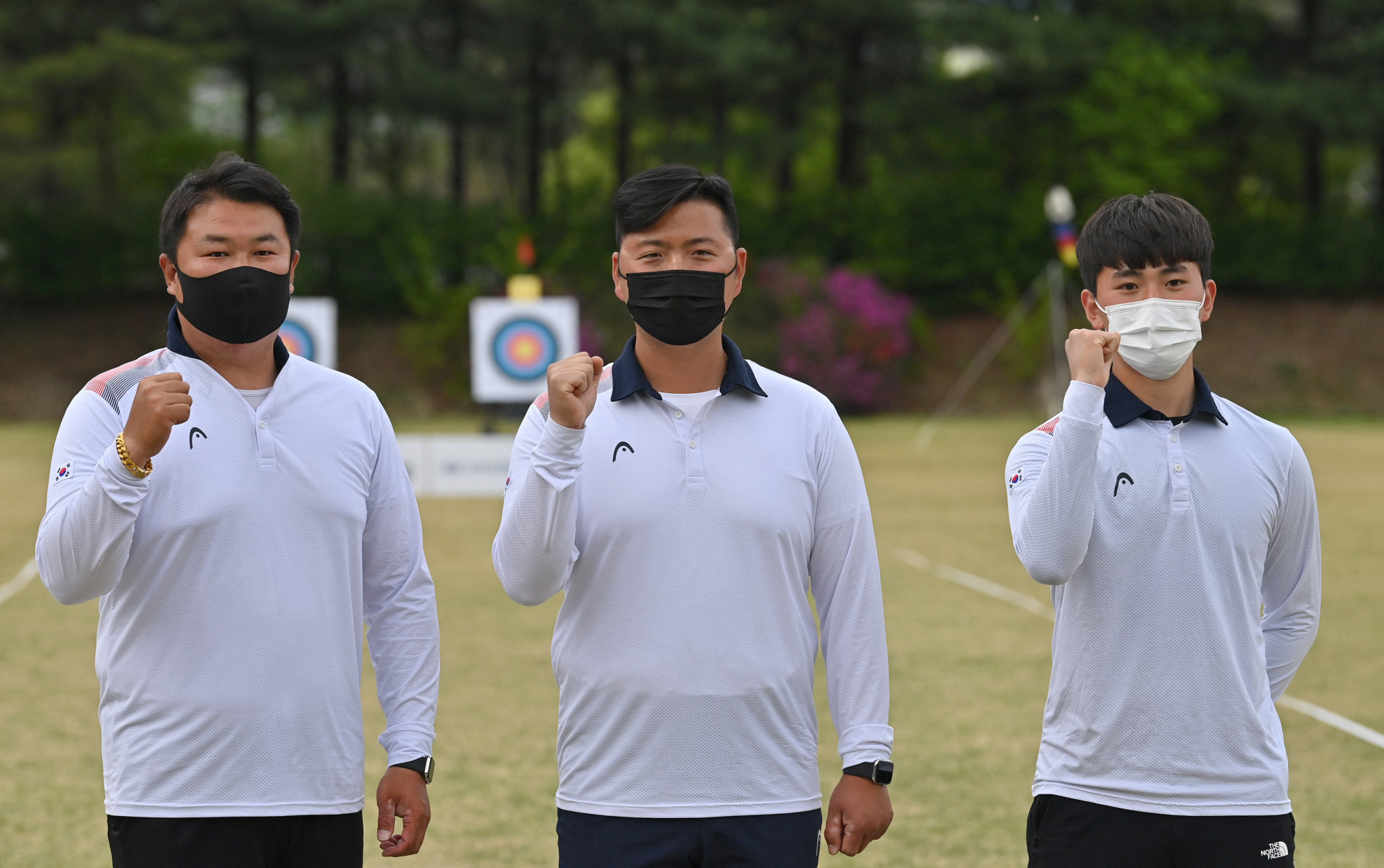 Seventeen-year-old Kim Je-deok, right, joins Olympic gold medallists Kim Woo-jin, centre, and Oh Jun-hyek in South Korea's men's archery team ©Getty Images