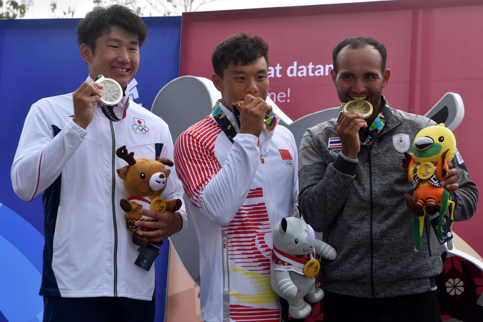 Quan Xin, centre, is the reigning Asian Games champion ©Getty Images