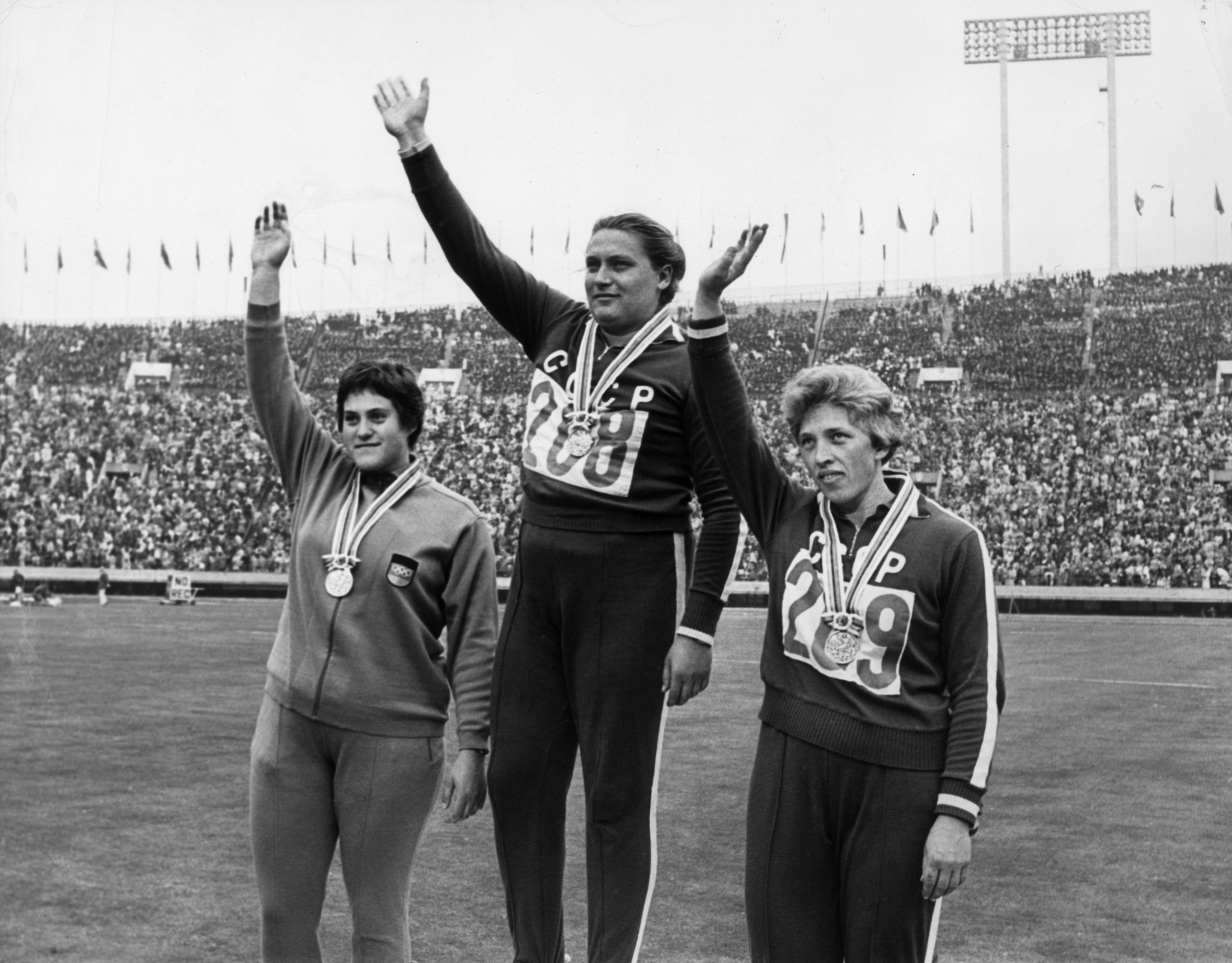Tamara Press on the podium after winning shot put gold at Tokyo 1964 in a new Olympic record ©Getty Images