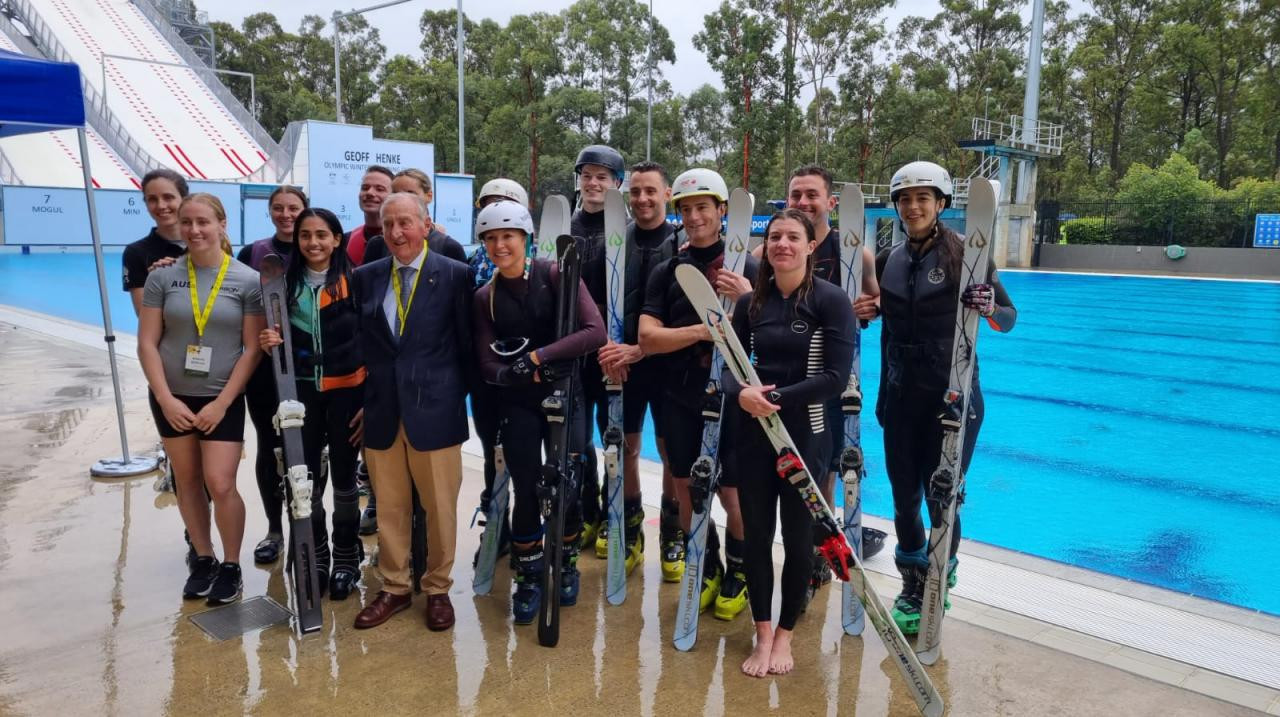 The newly opened Australian freestyle skiing centre, named after long-serving AOC member Geoff Henke - pictured front - is boosting medal prospects for the Beijing 2022 Winter Games ©AOC