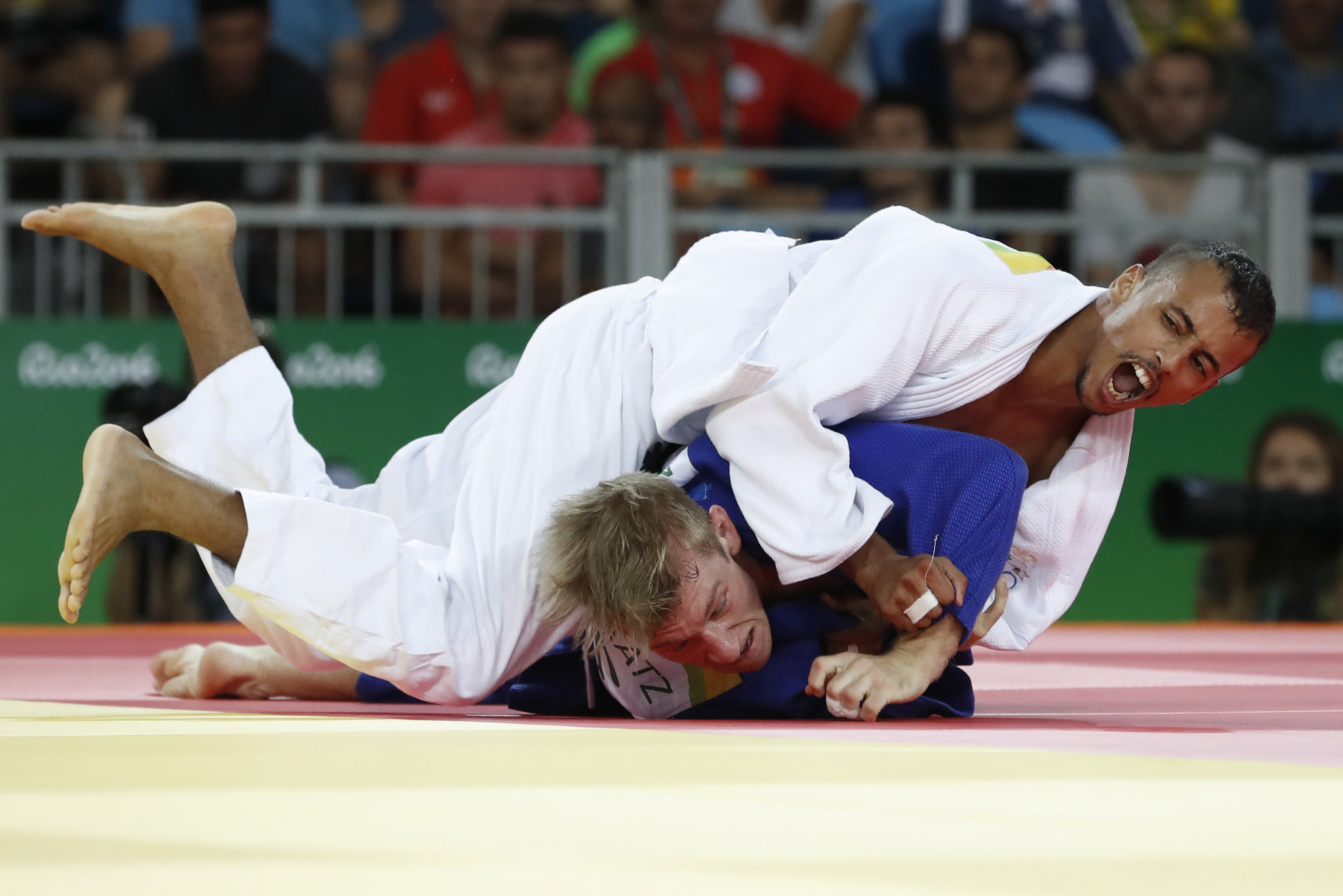 Imad Bassou, in white, is set to compete for the bronze in the men's under-66kg ©Getty Images