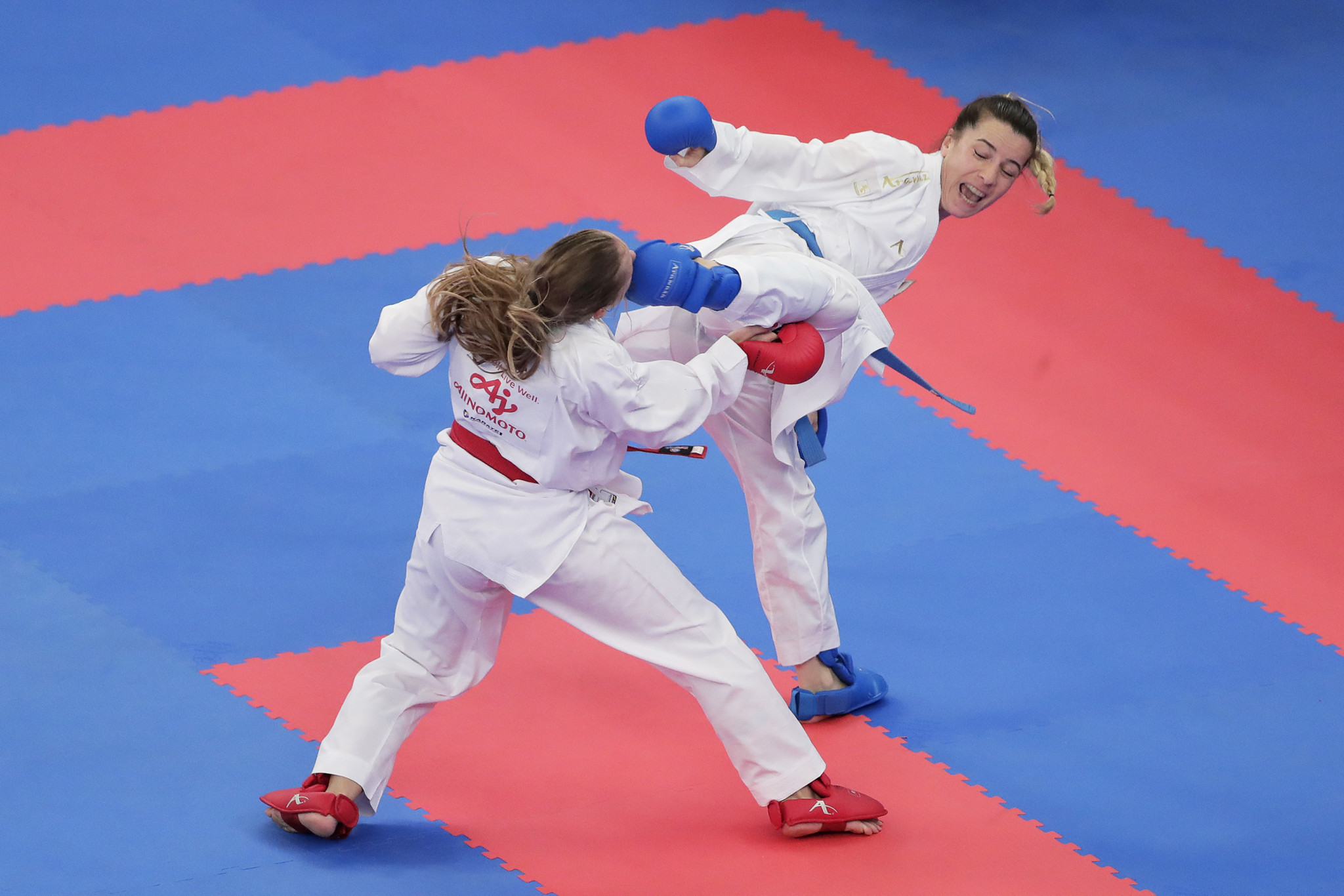 World ranking leader Serap Ozcelik Arapoglu, in blue, produced a dominant display to reach the final of the women's kumite under-50kg category in Porec ©Getty Images