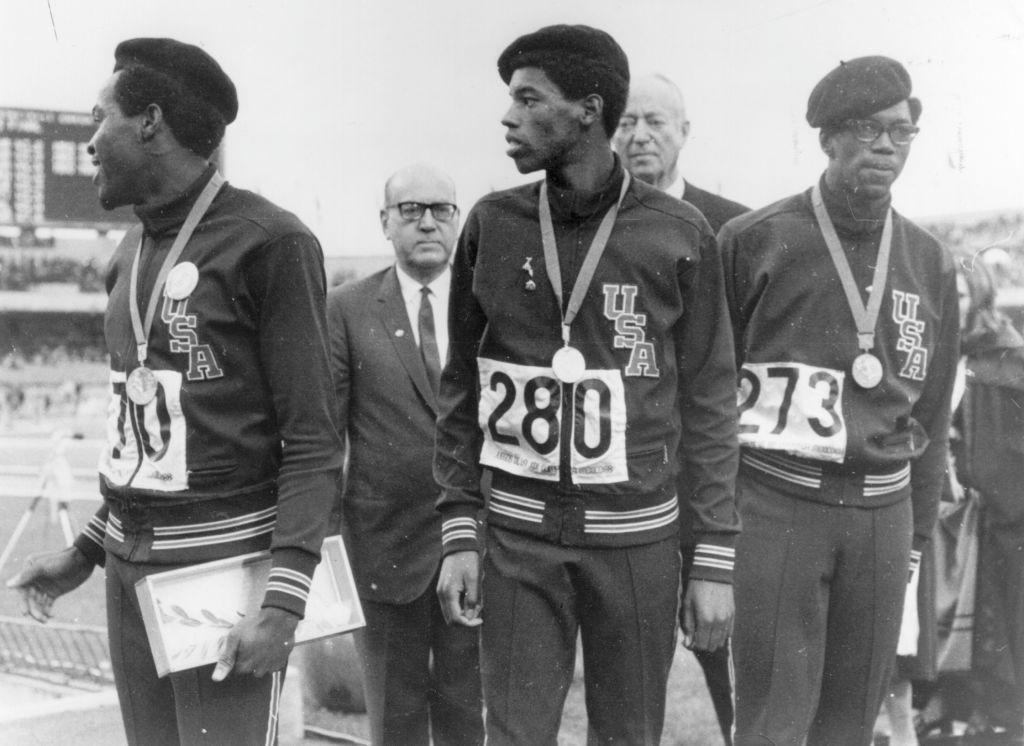 Lee Evans, centre, and his fellow medallists in the 1968 Olympic 400m final wore black berets in solidarity with the Black Panther movement despite being warned not to follow the lead set by the earlier 200m podium protest of Tommie Smith, John Carlos and Peter Norman ©Getty Images
