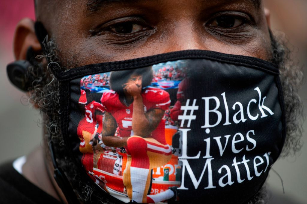 The initiative taken by San Francisco 49ers quarterback Colin Kaepernick of taking a knee during the US national anthem to protest against social and racial inequalities has become intertwined with the Black Lives Matter movement ©Getty Images