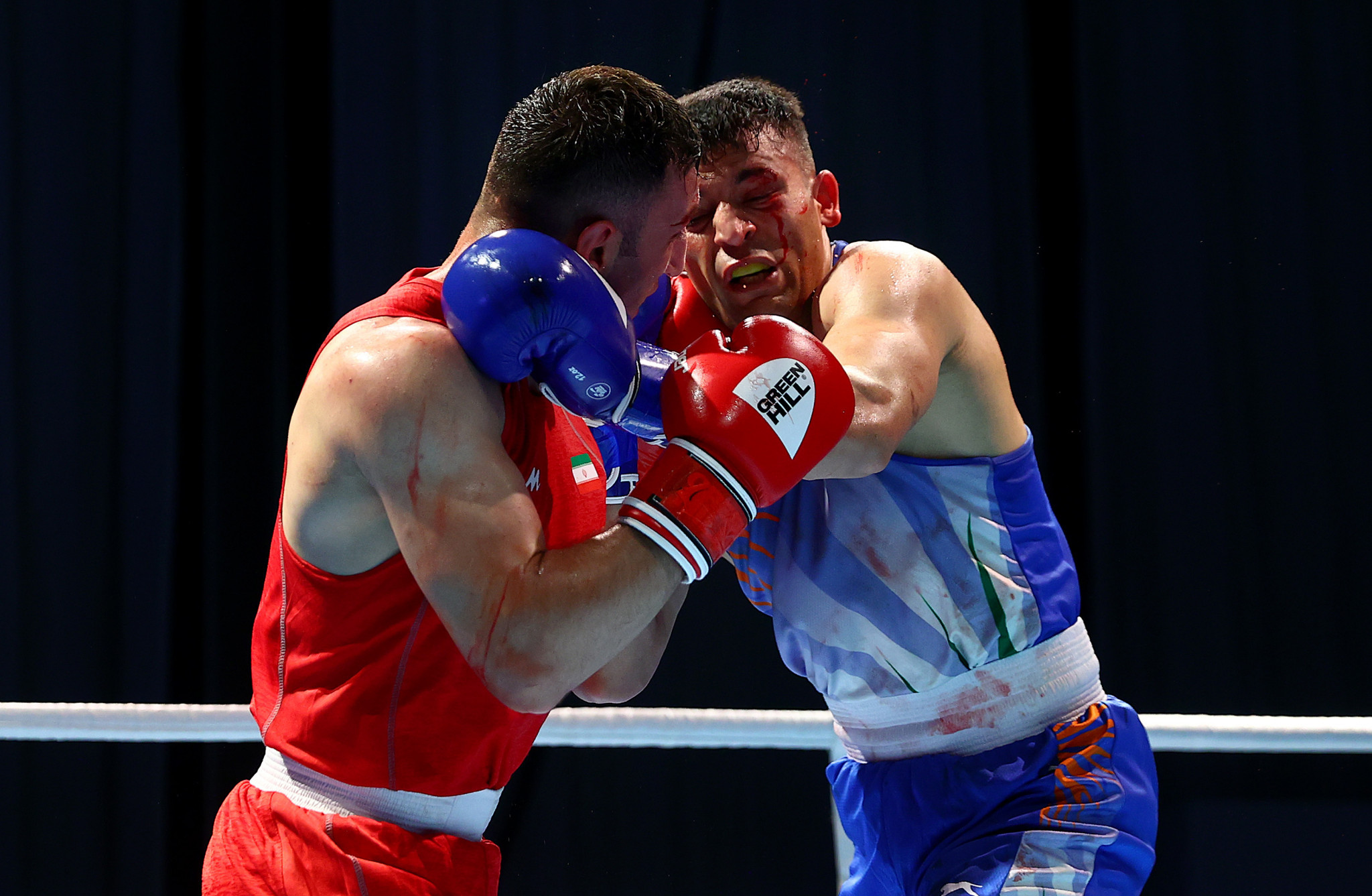 Meysam Gheshlaghi, in red, was one of four Iranian boxers to record wins on day one of the ASBC Elite Boxing Championships in Dubai ©Getty Images