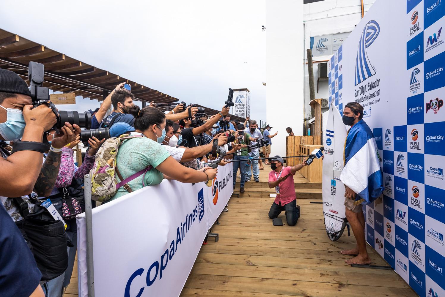 Home surfer Bryan Perez, representing El Salvador, speaks to the media after winning his repechage heat ©ISA/Sean Evans