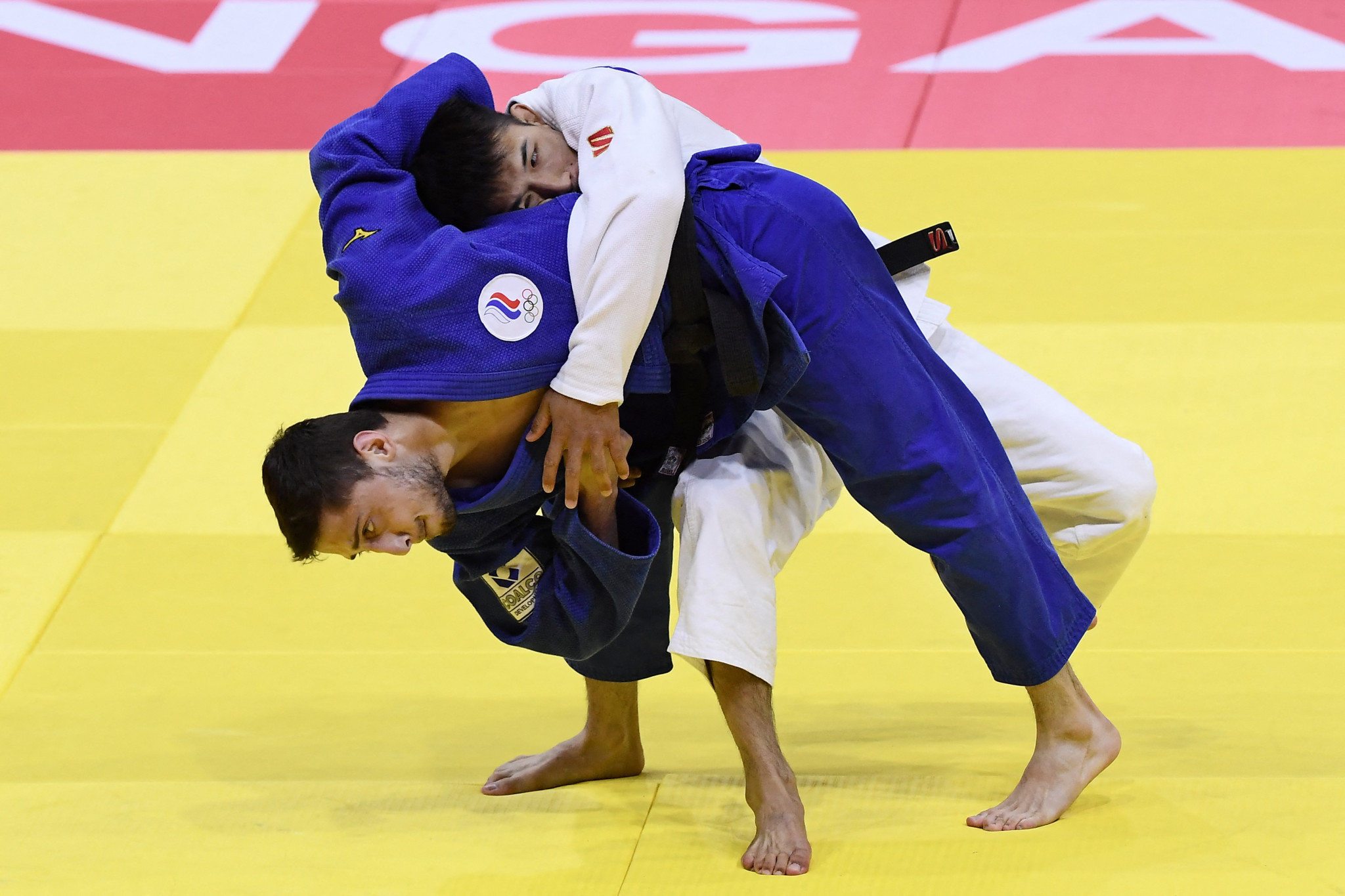 Yago Abuladze proved too strong for Gusman Kyrgybayev in the men's under-60kg on the opening day of action in Budapest ©Getty Images
