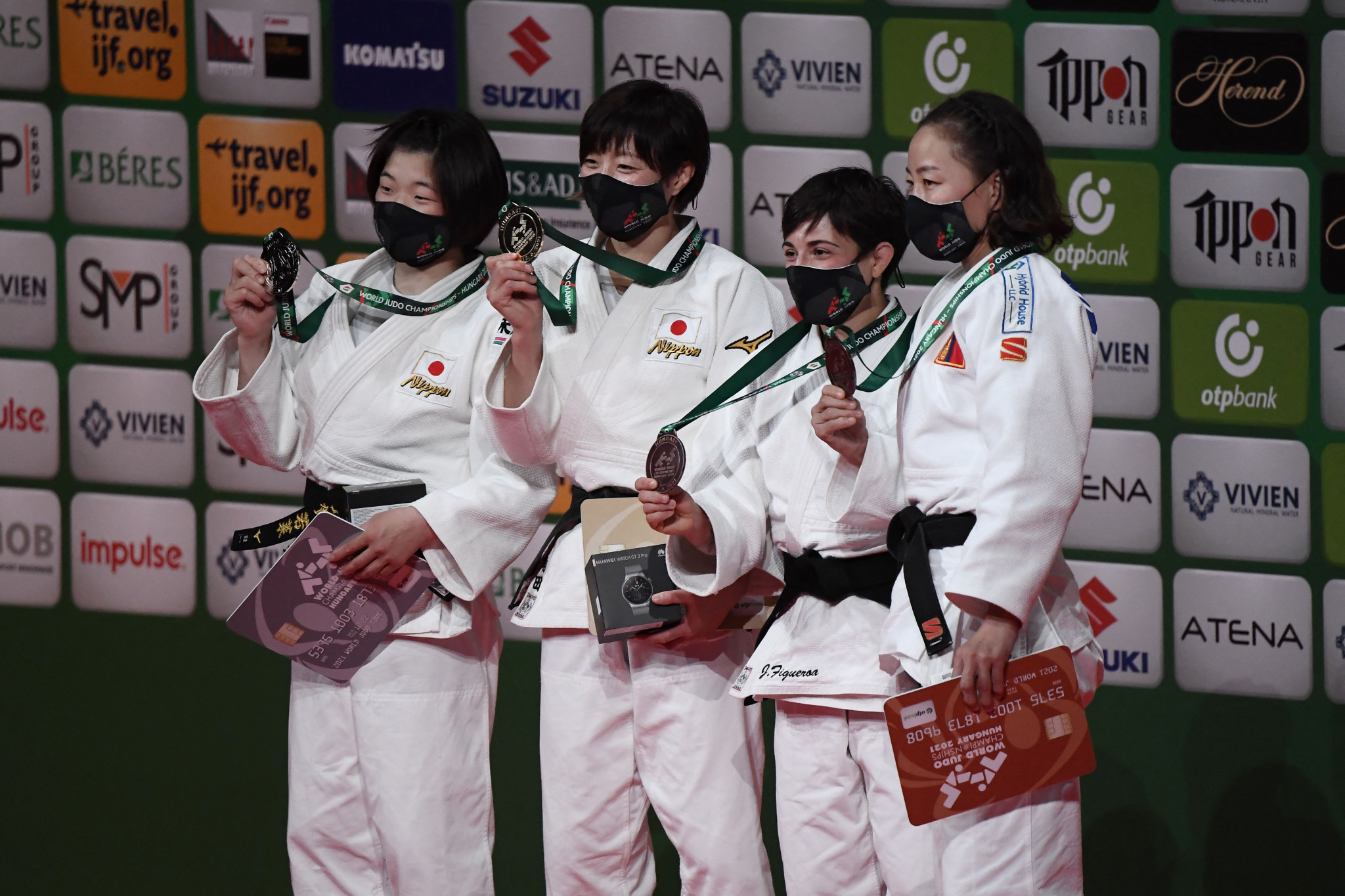 Natsumi Tsunoda, second from left, tops the podium after winning women's under-48 kg gold ©Getty Images