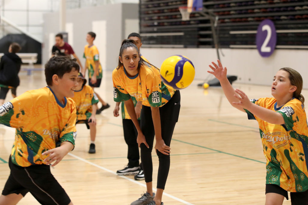 """Australian beach volleyball Olympian Taliqua Clancy plays with students during the launch of the Australian Olympic Committee """"Reflect"""" Reconciliation Action Plan at Nissan Arena in Brisbane ©Getty Images"""