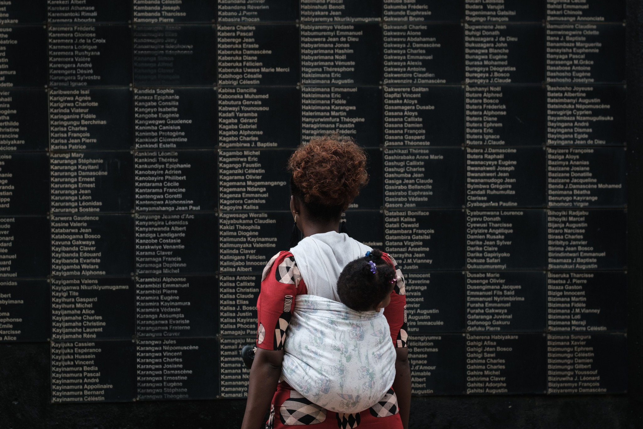 A mother carries her child at the Rwandan Genocide Memorial in Kigali ©Getty Images