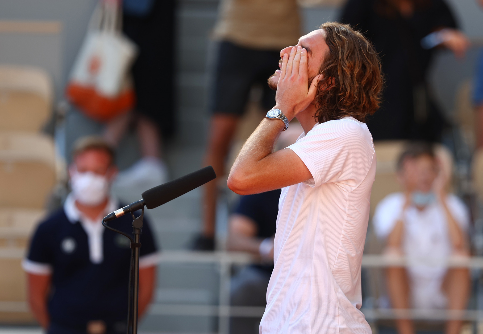 An emotional Stefanos Tsitsipas gives a tearful on-court interview after becoming the first Greek player to reach a Grand Slam final ©Getty Images