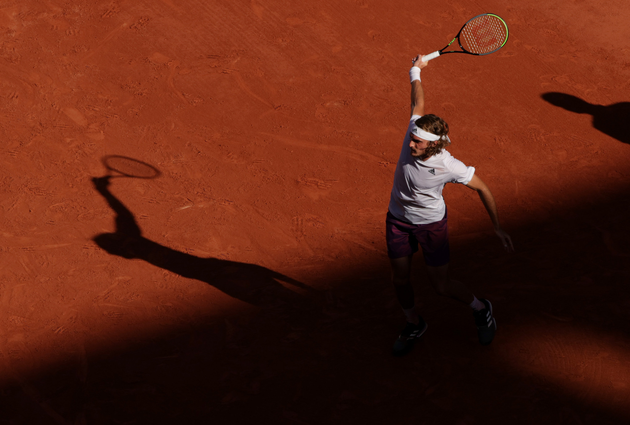 Tsitsipas plays a flourishing backhand on the way to a five-set victory over Zverev on a marathon day of men's semi-final action in Paris ©Getty Images