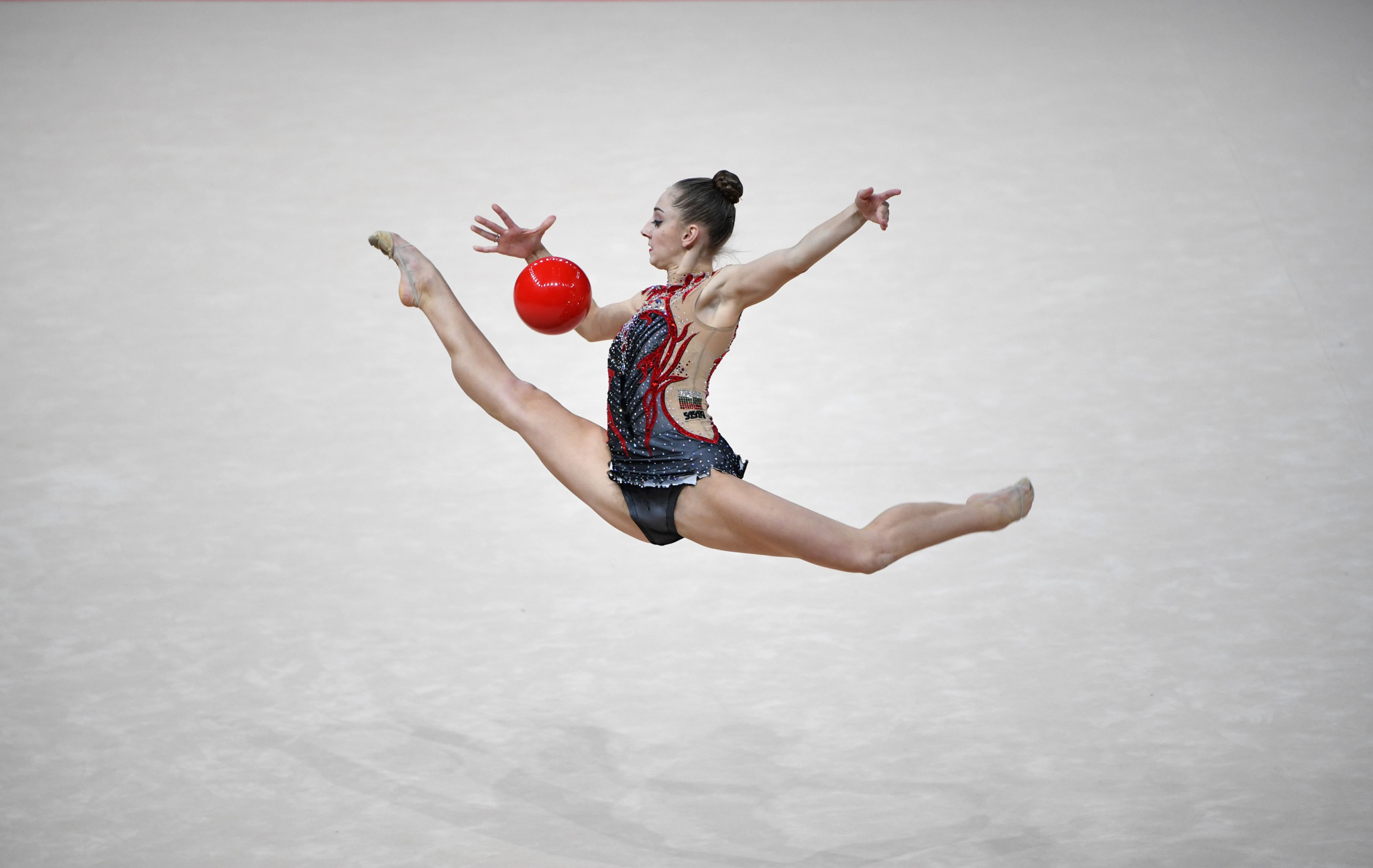 Boryana Kaleyn of Bulgaria split the Averina twins as she took silver in the senior individual all-around final ©Getty Images