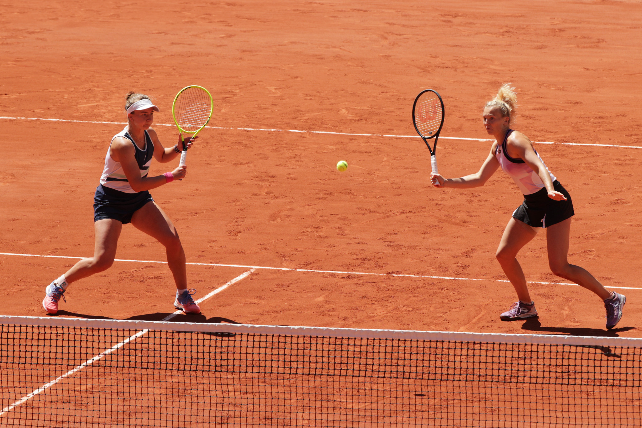 Czech Barbora Krejčíková, left, became the first player to win the women's singles and doubles at the French Open since 2000, as she a compatriot Kateřina Siniaková tasted victory in the doubles final today ©Getty Images