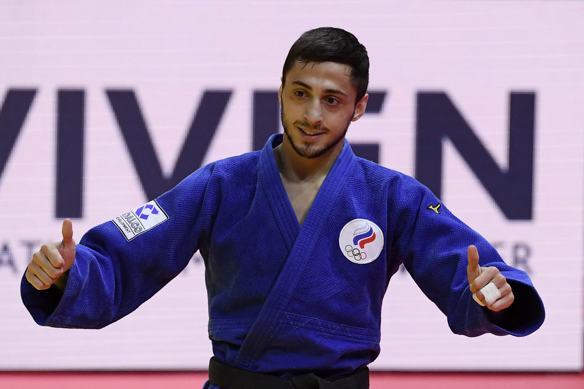 Yago Abuladze won gold at the World Judo Championships in Budapest and was presented with his medal by Yekaterinburg Governor Yevgeny Kuyvashev ©Getty Images