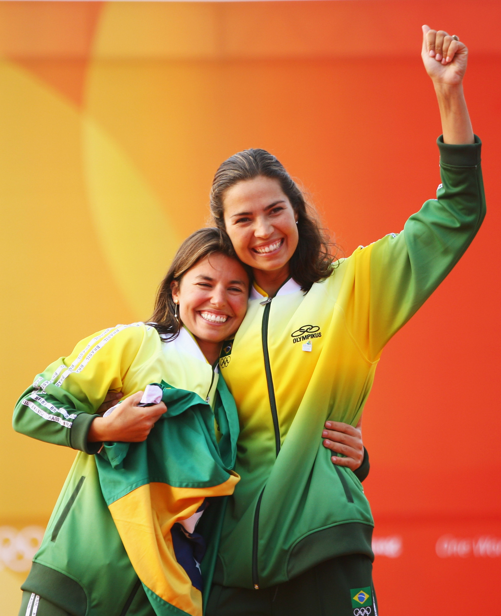 Isabel Swan, right, celebrates winning an Olympic sailing medal in the 470 class with Fernanda Oliveira at Beijing 2008 ©Getty Images