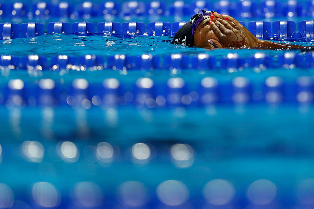 Simone Manuel, who at the Rio 2016 Games became the first African-American swimmer to win Olympic gold, reacts with relief after qualifying in the 50m freestyle on the final day of the US trials in Omaha ©Getty Images