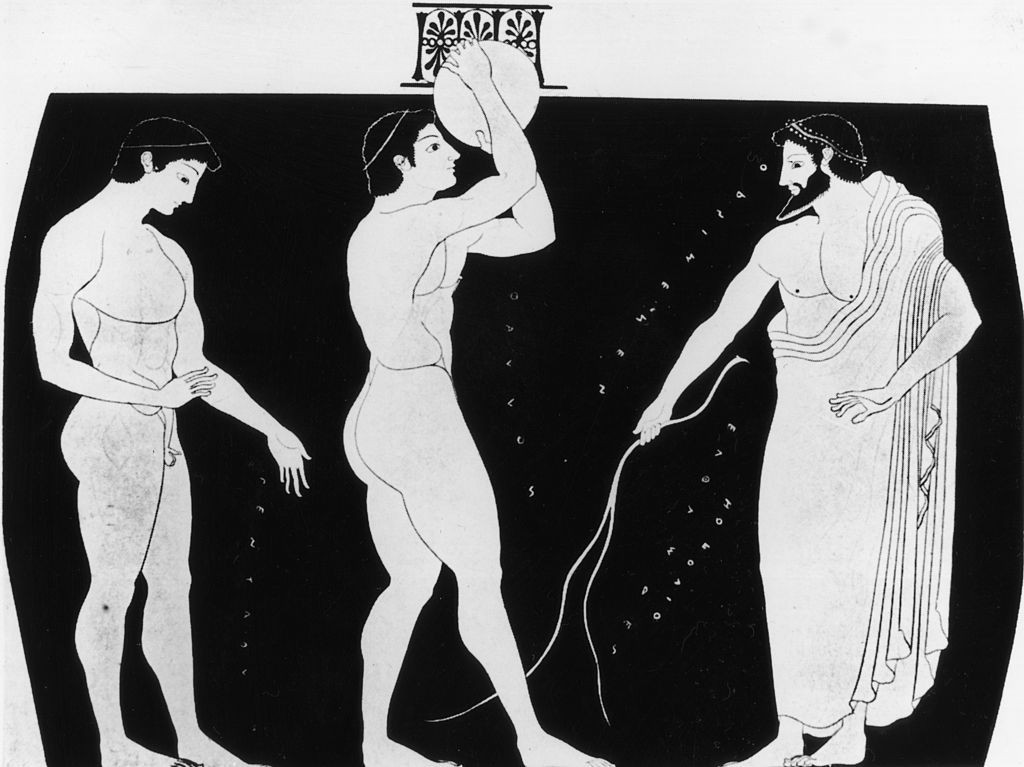 Greek pottery from circa 500 BC showing a discus thrower preparing to take part in the ancient Greek Olympics ©Getty Images