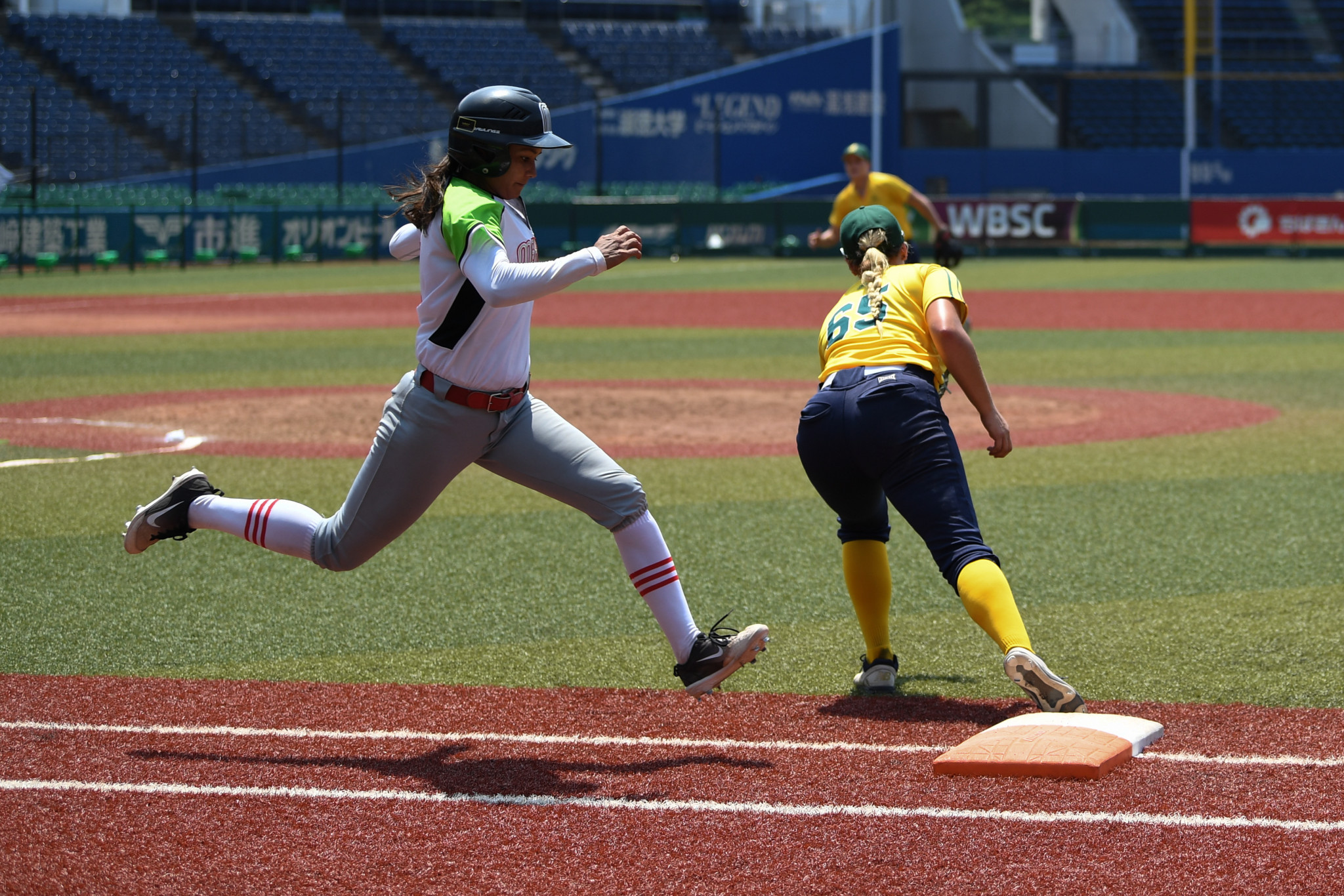 Two first-base bags will be used in softball to avoid collisions ©Getty Images