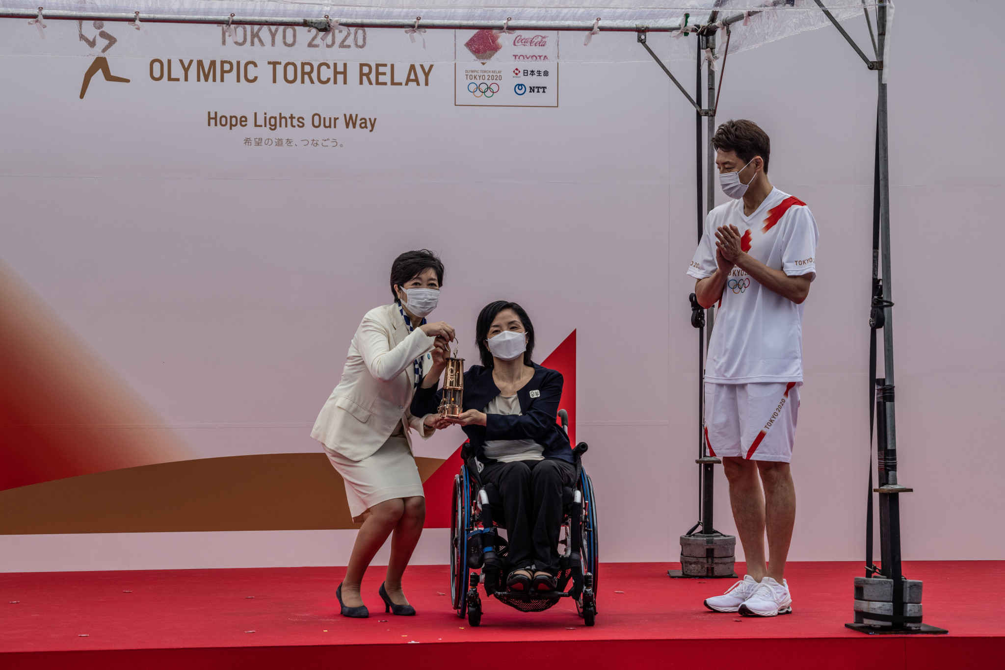 Subdued Tokyo leg of Olympic Torch Relay begins away from public