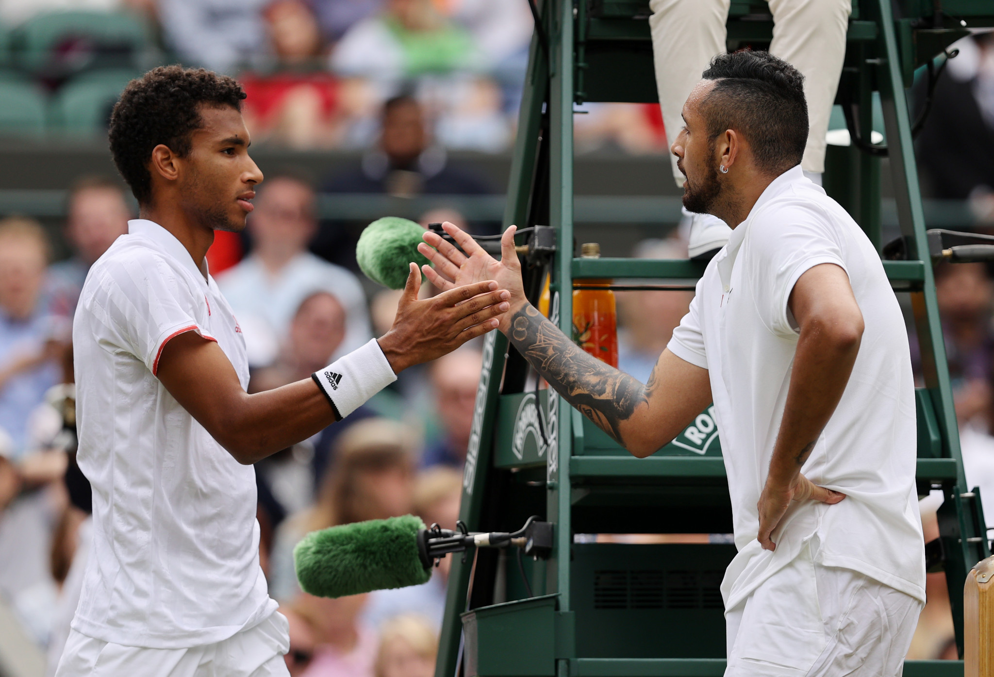 Nick Kyrgios, right, retired hurt in his third-round match against Canadian Felix Auger-Aliassime at Wimbledon ©Getty Images