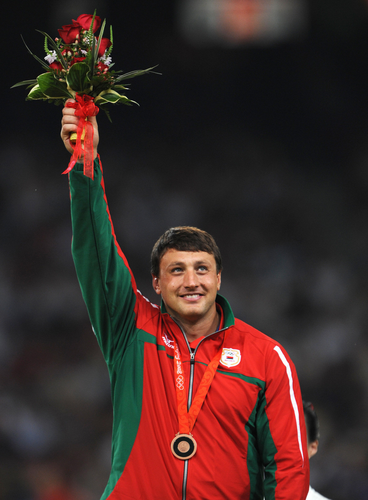 Ivan Tsikhan celebrates winning the Olympic bronze medal in the hammer at Beijing 2008 before he was stripped of it and then had it returned following a technicality ©Getty Images