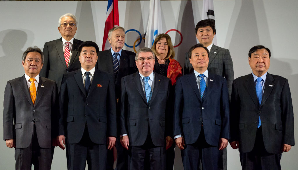Gunilla Lindberg, back row, middle right, speaks next to Gian-Franco Kasper to her left at a North and South Korean Olympic participation meeting before Pyeongchang 2018 ©Getty Images