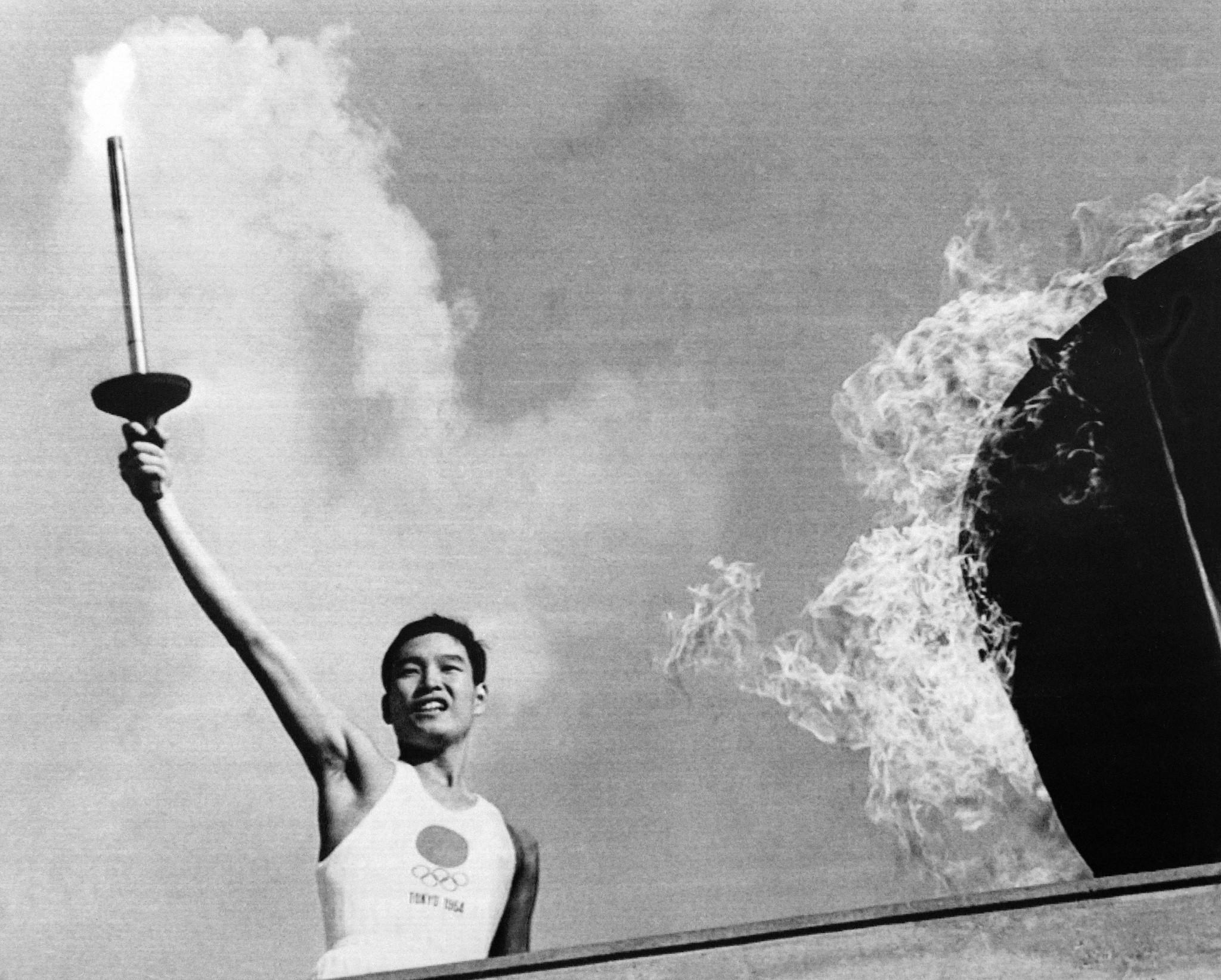 Yoshinori Sakai lit the Olympic Cauldron at the Tokyo 1964 Opening Ceremony ©Getty Images
