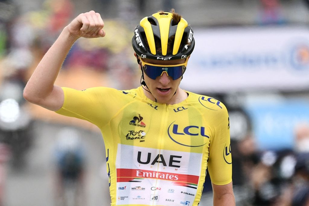 Pogačar set to retain Tour de France title after negotiating time trial won by van Aert