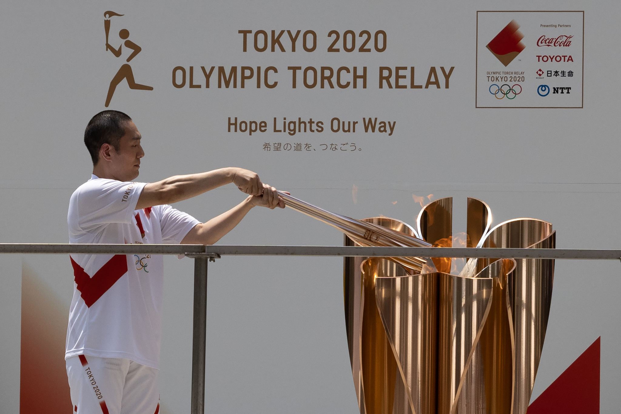 Low-key arrival for Olympic Torch in Tokyo before journey to Opening Ceremony