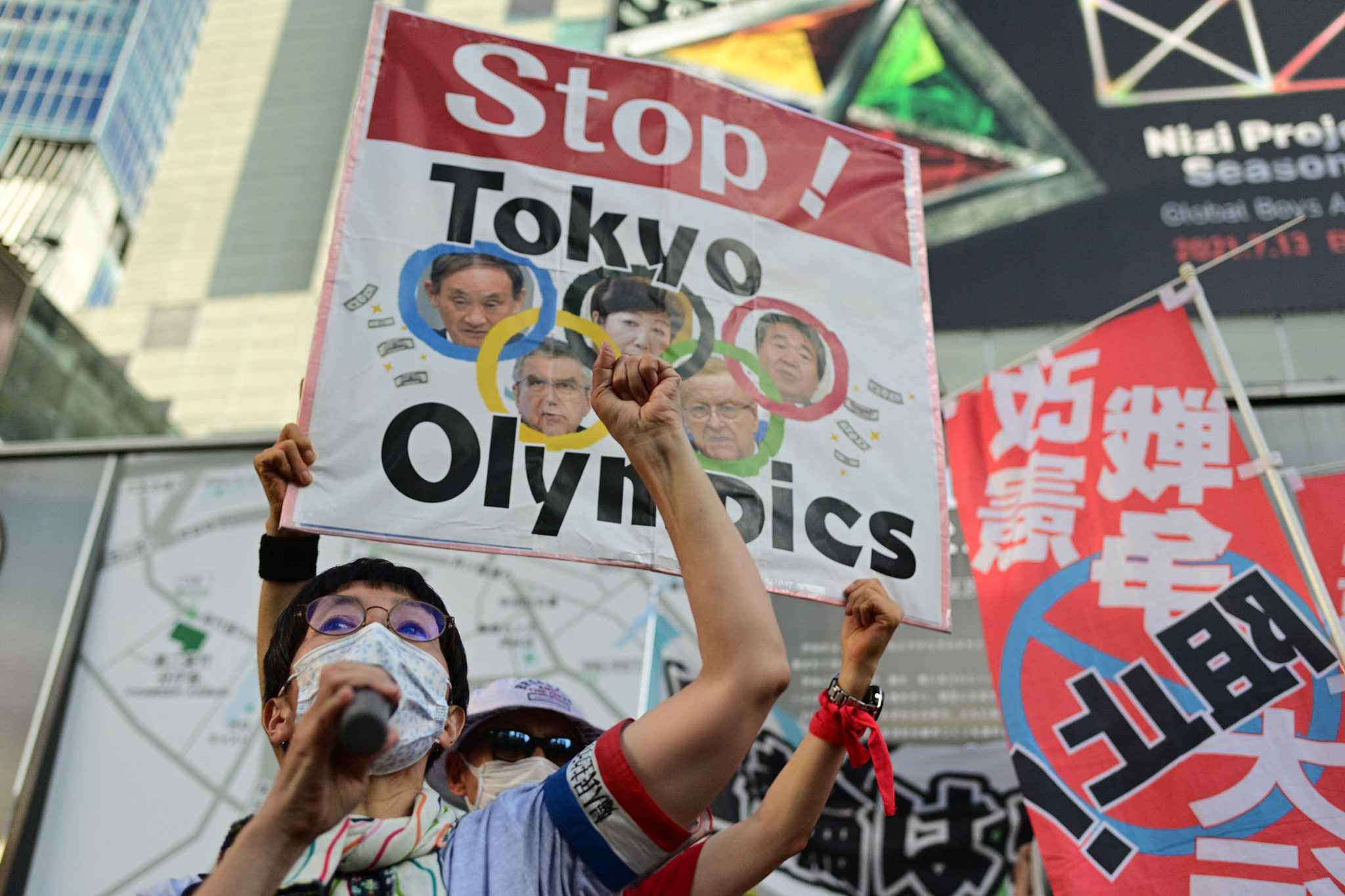 Protesters make voices heard at Tokyo 2020 Opening Ceremony