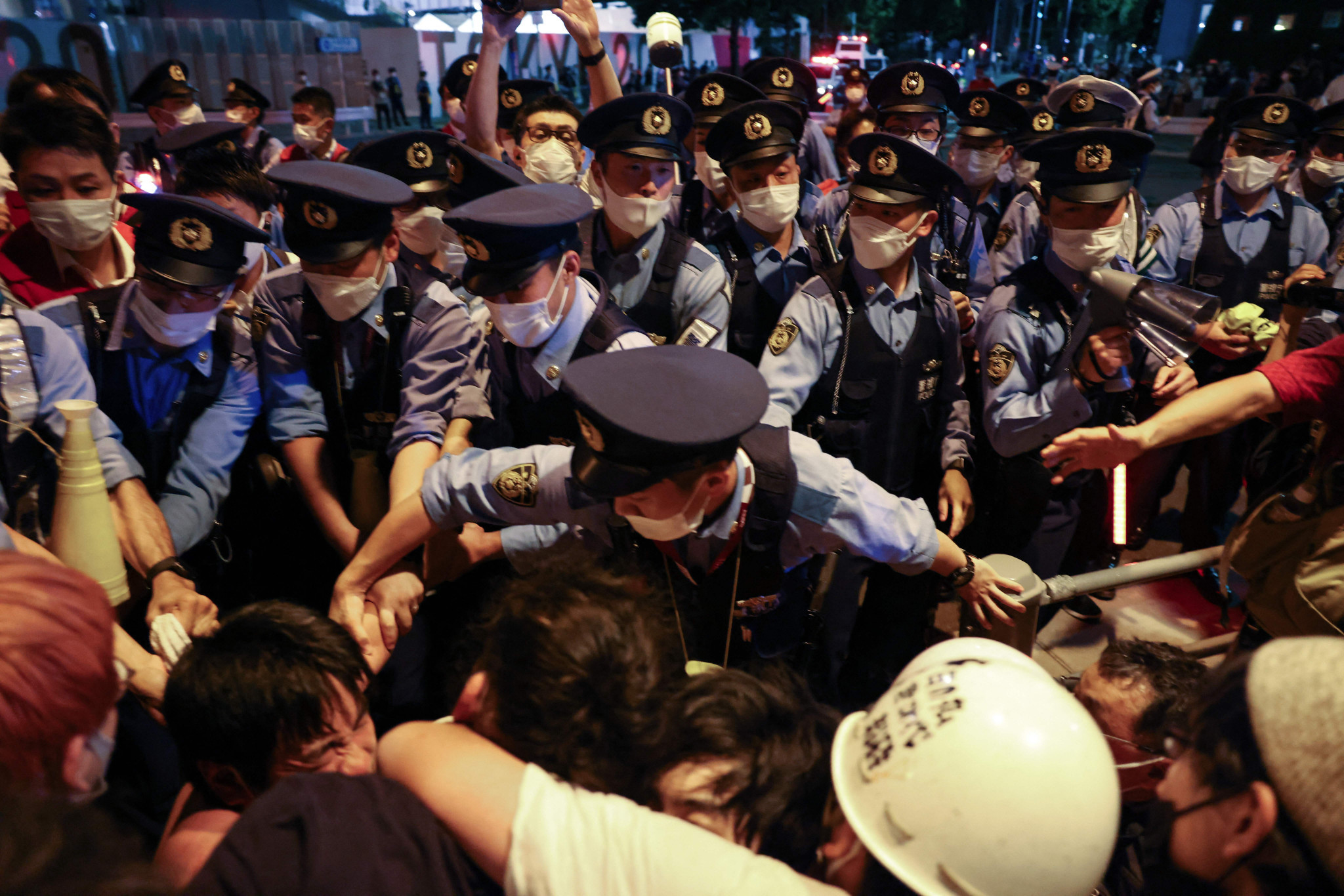 Security guards force protesters back as frustrations boiled over in Tokyo ©Getty Images
