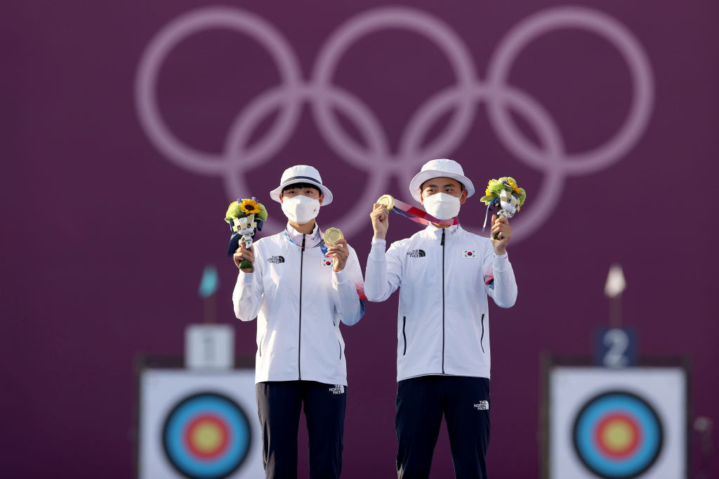 Young South Koreans An and Kim win first Olympic archery mixed team title