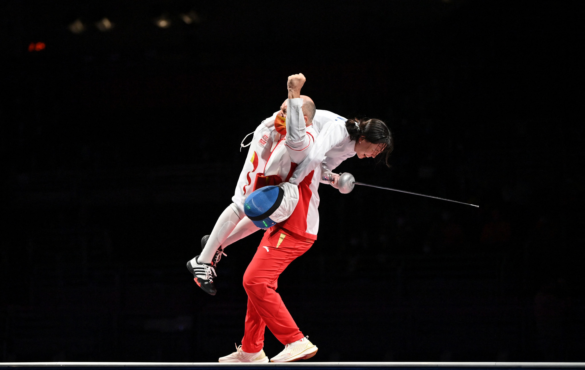 China's Sun Yiwen is lifted off her feet by her coach Hugues Obry after winning the women's épée individual gold medal ©Getty Images