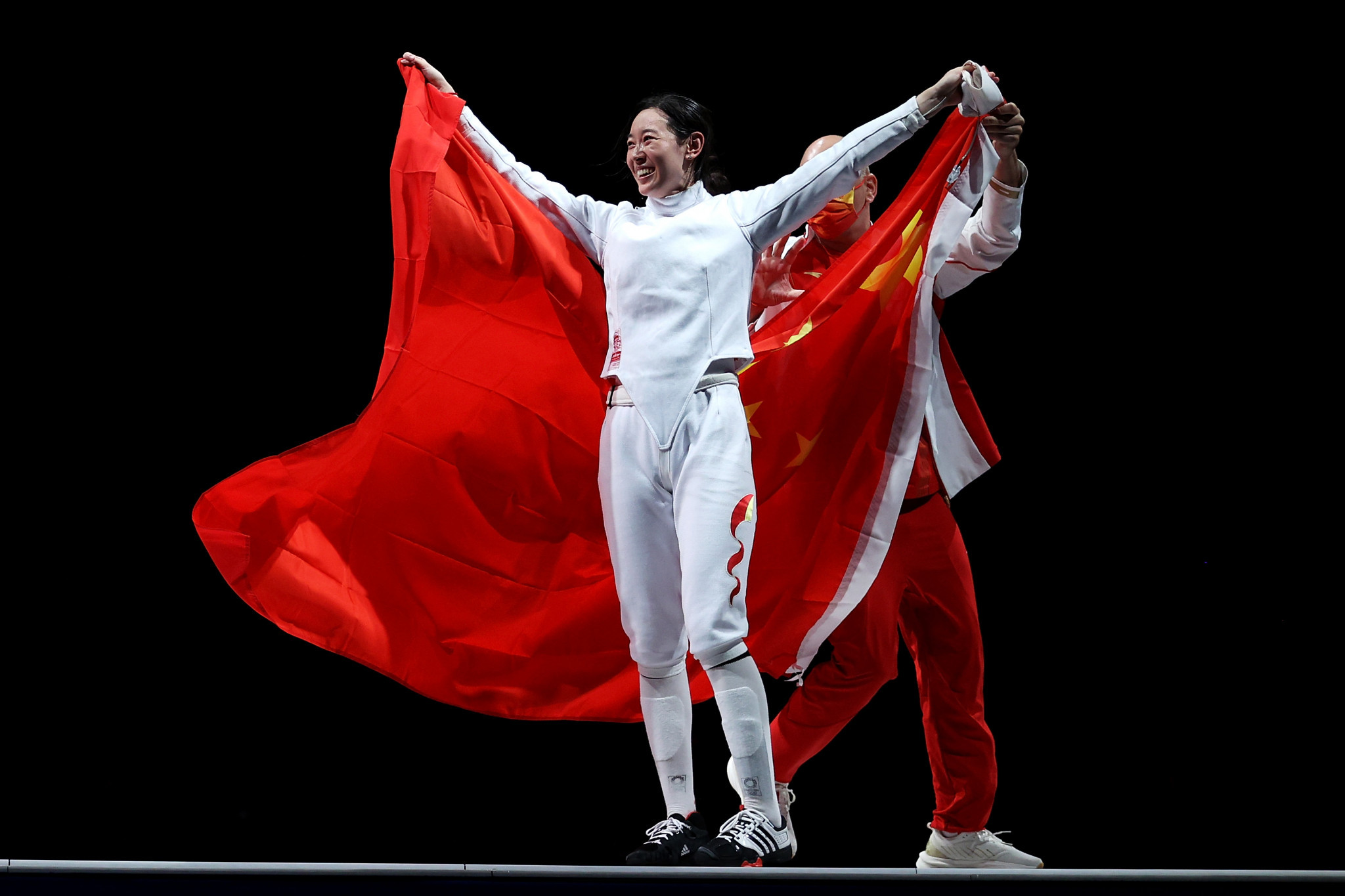 Yiwen Sun of China celebrates with her coach after winning the gold medal in the women's épée individual ©Getty Images