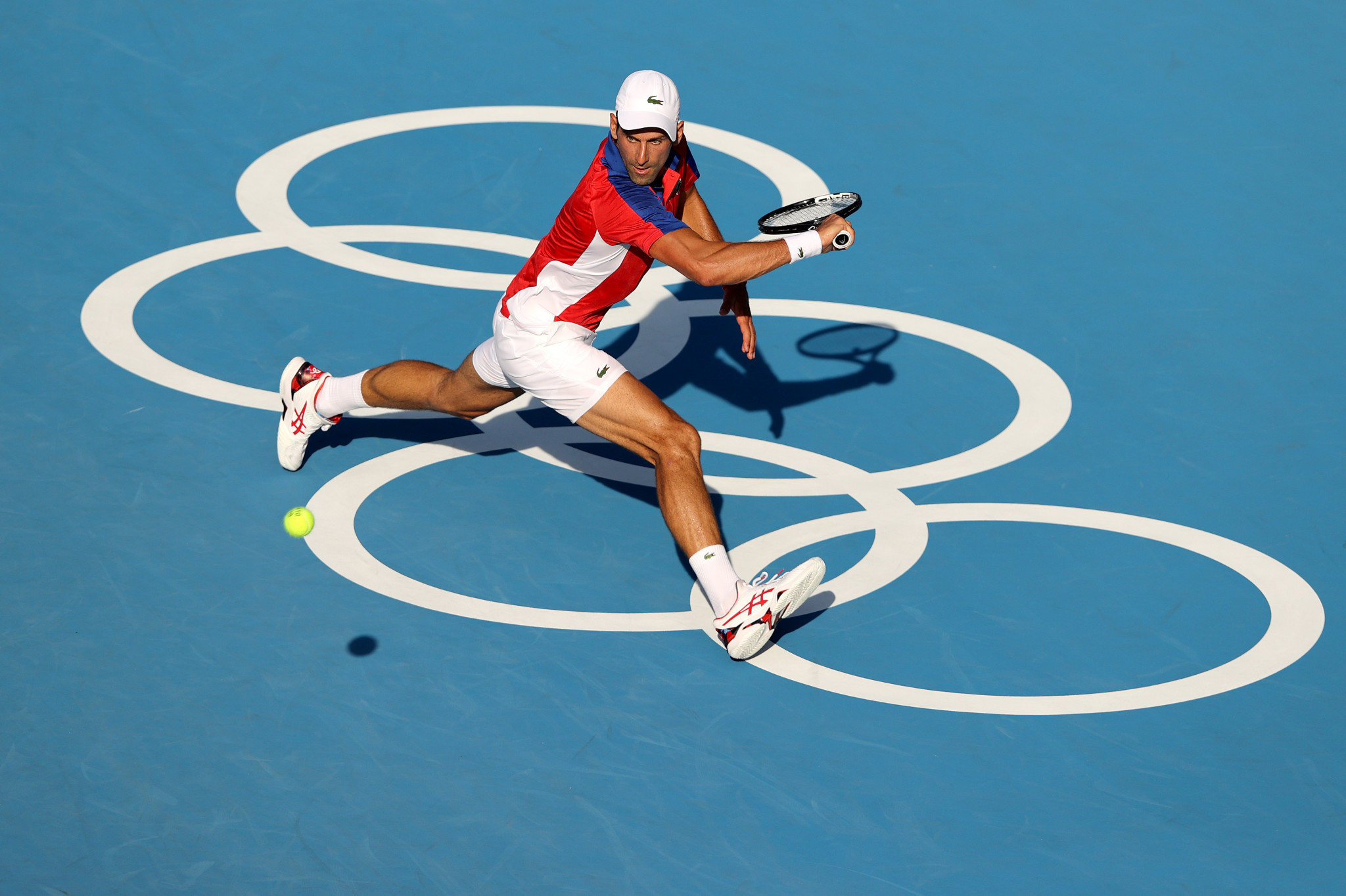 Novak Djokovic stretches to retrieve the ball as he began his quest for gold in the men's tennis tournament ©Getty Images