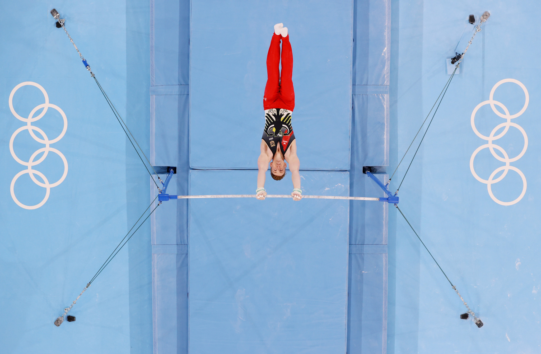 Nils Dunkel of Germany competes on the horizontal bar during the men's qualification round ©Getty Images