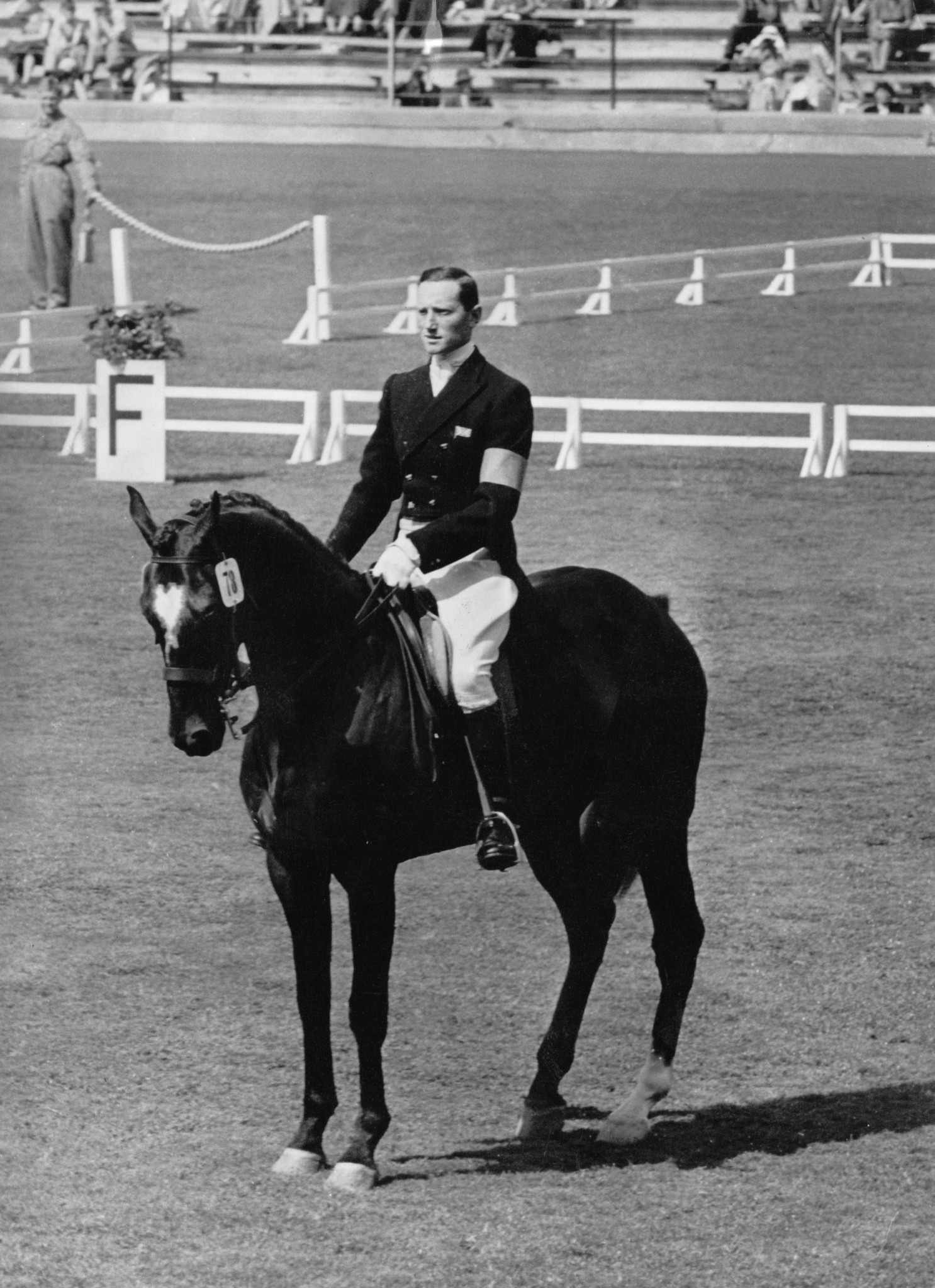Bertie Hill on Countryman V in front of Queen Elizabeth II at the 1956 Stockholm Olympics ©Getty Images