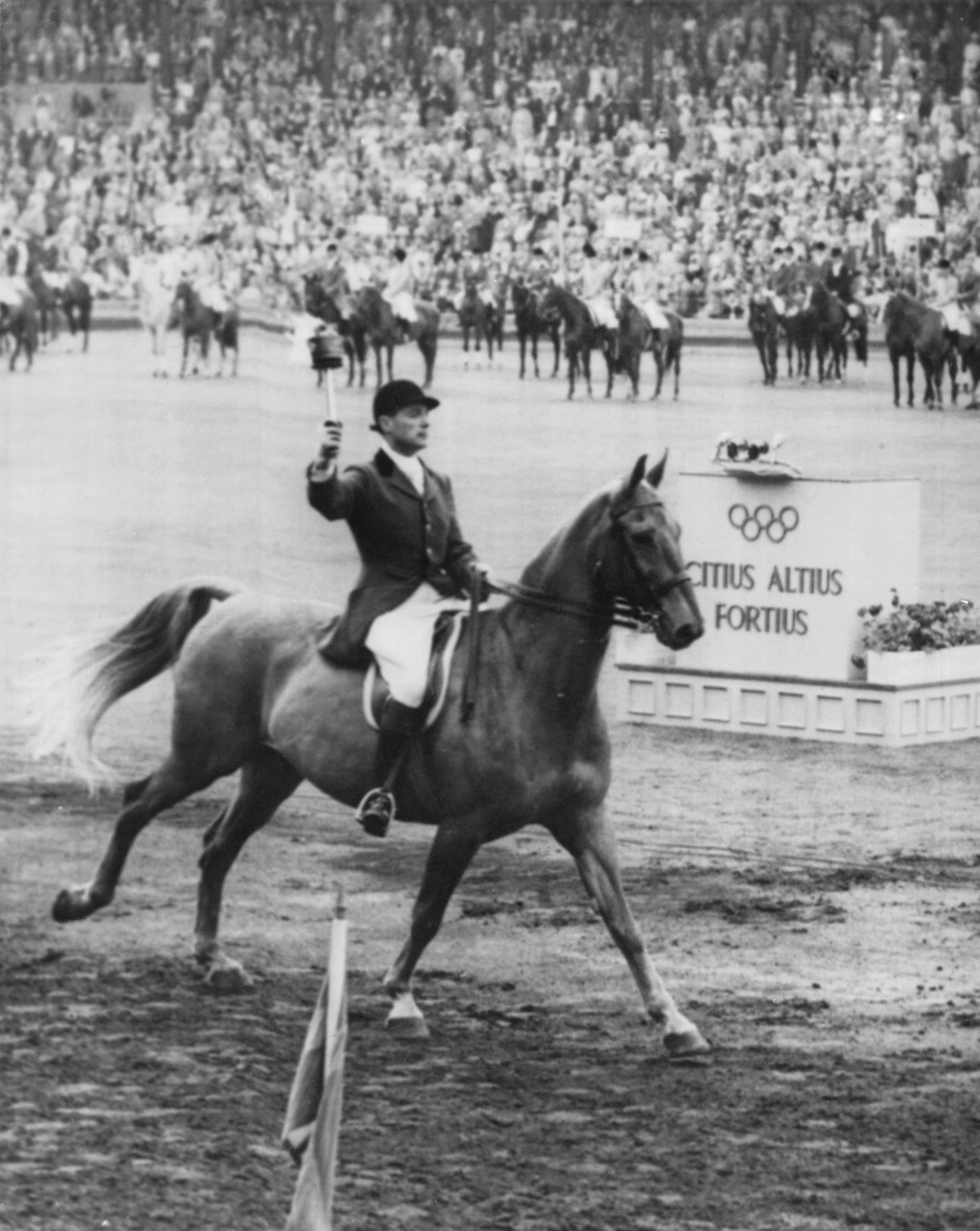Swedish equestrian rider Hans Wilkne carried the Olympic torch into the Stockholm Olympic Stadium ©Getty Images