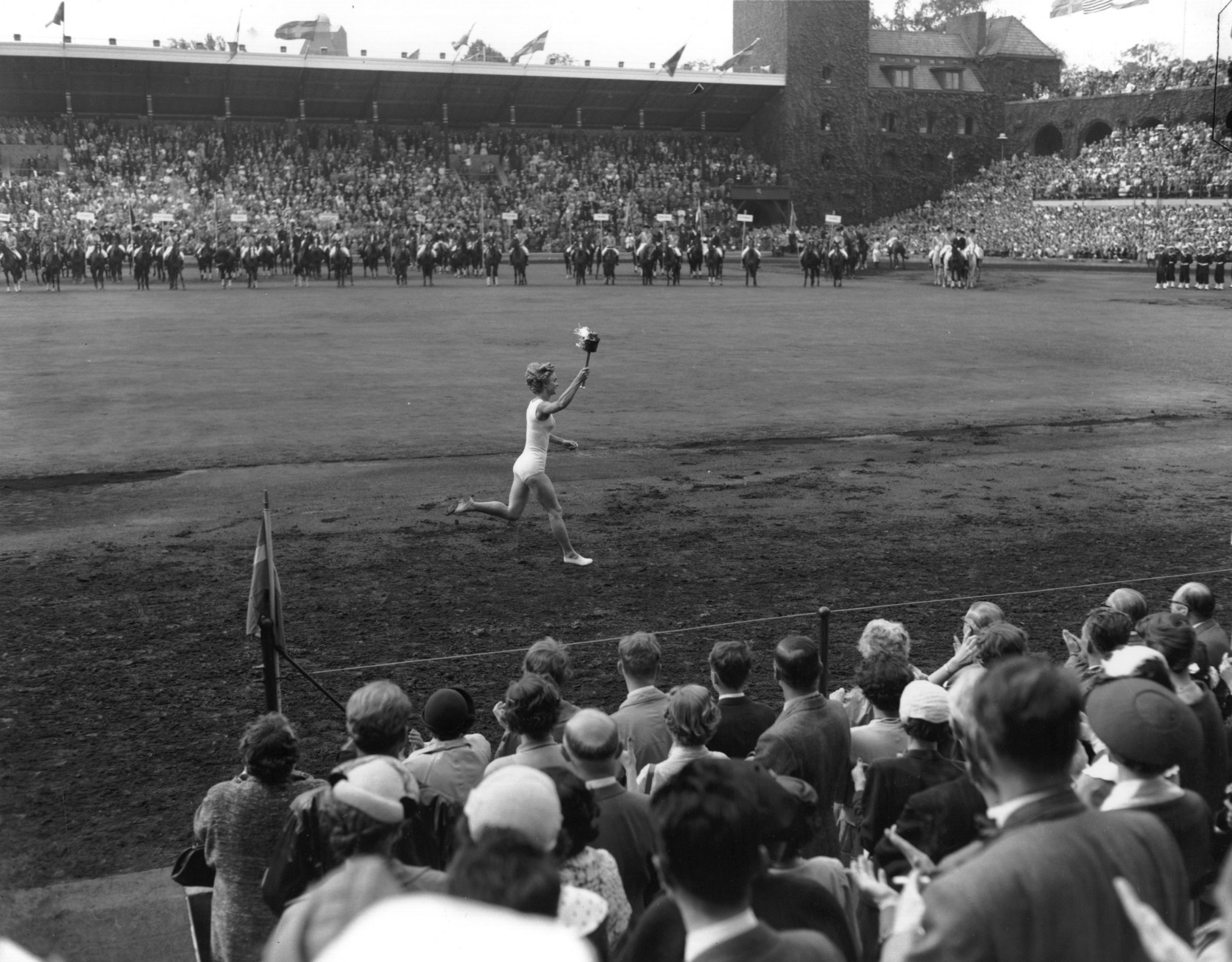 1952 gymnastics champion Karin Lindberg was the first woman to carry an Olympic Flame in the stadium ©Getty Images