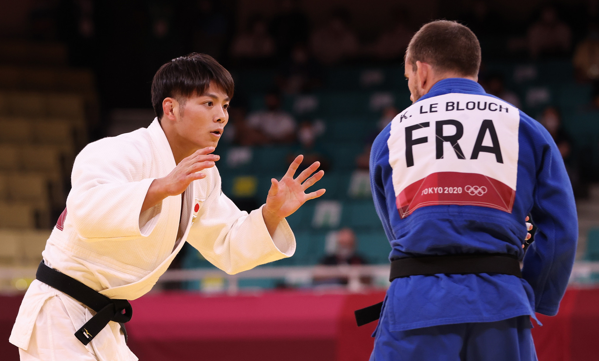 Japan's Hifumi Abe, left, won a judo gold medal in the men's under-66kg division ©Getty Images