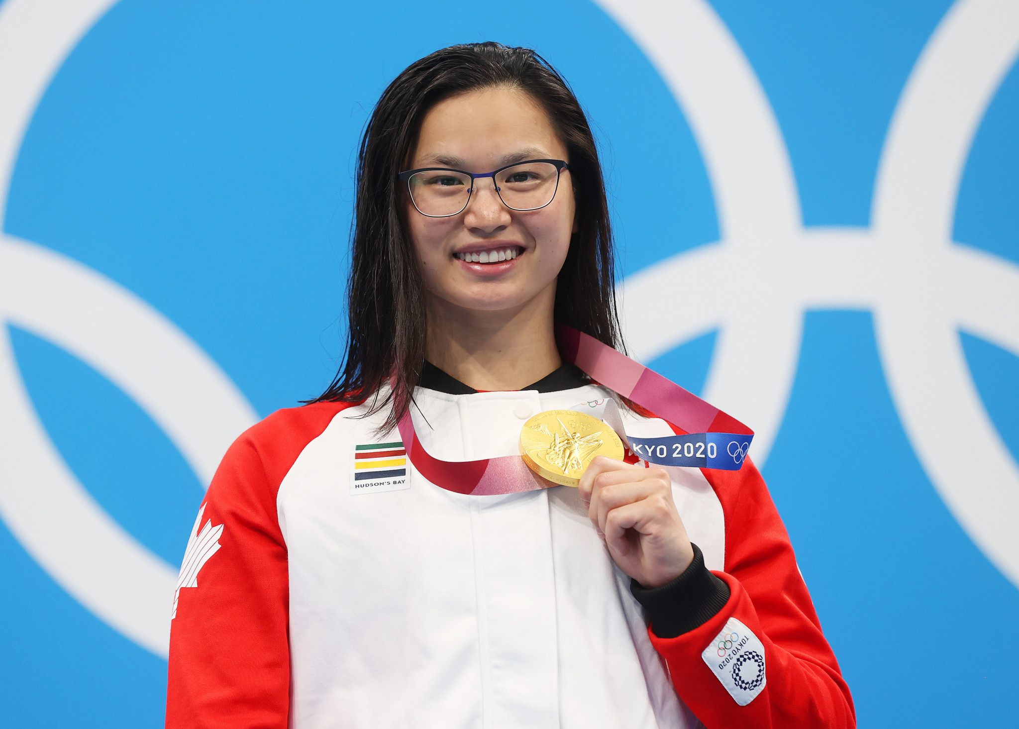 Canada's Maggie Manceil shows off her  Olympic gold medal she won in the 100m butterfly ©Getty Images