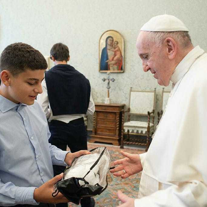 GAMMA Italy representative Gianmaria Leonardi's son, Matteo, presented the Pope with a pair of fighting gloves ©GAMMA