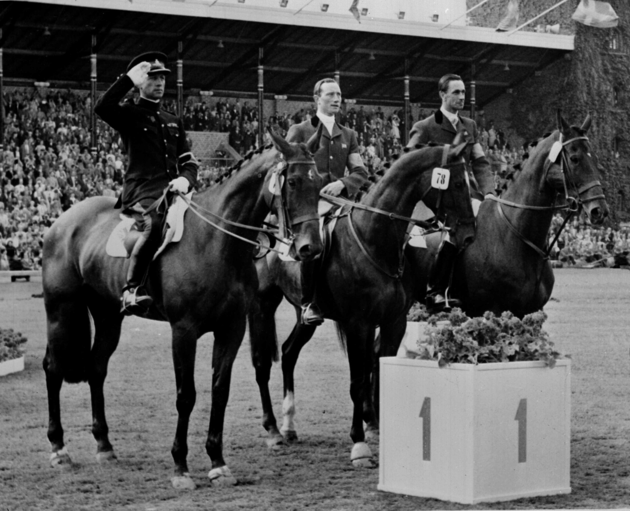 The British team - Frank Weldon, left, Bertie Hill, centre, and Laurence Rook, right - after winning the eventing team gold ©Getty Images
