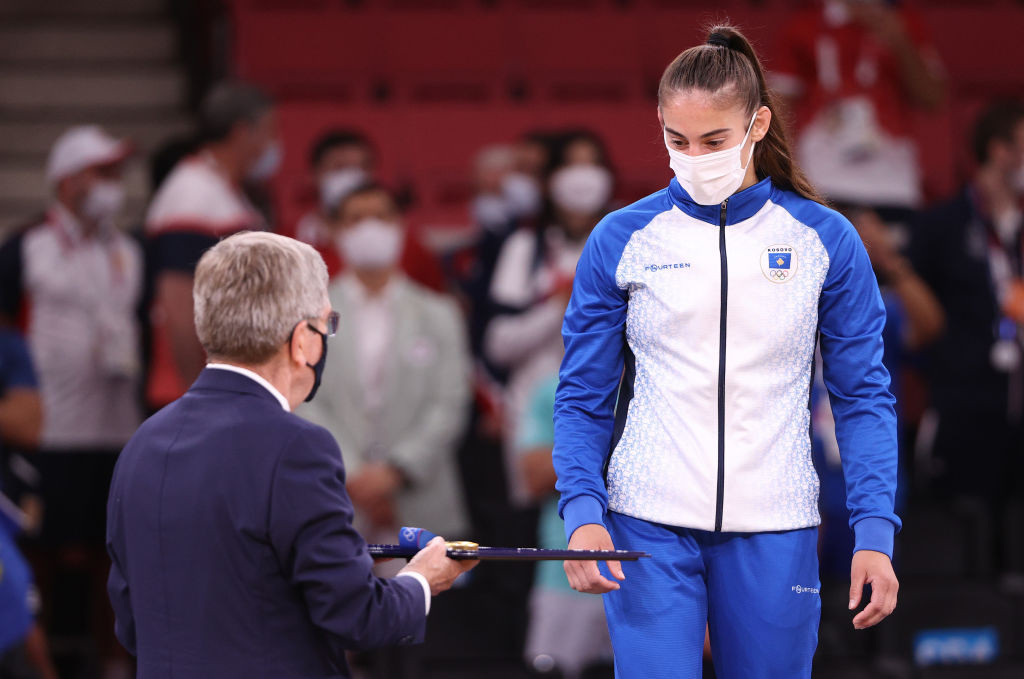 Nora Gjakova, Kosovo's third woman Olympic judo champion since it made its Games debut in Rio five years ago, receives her under-57kg medal from IOC President Thomas Bach ©Getty Images