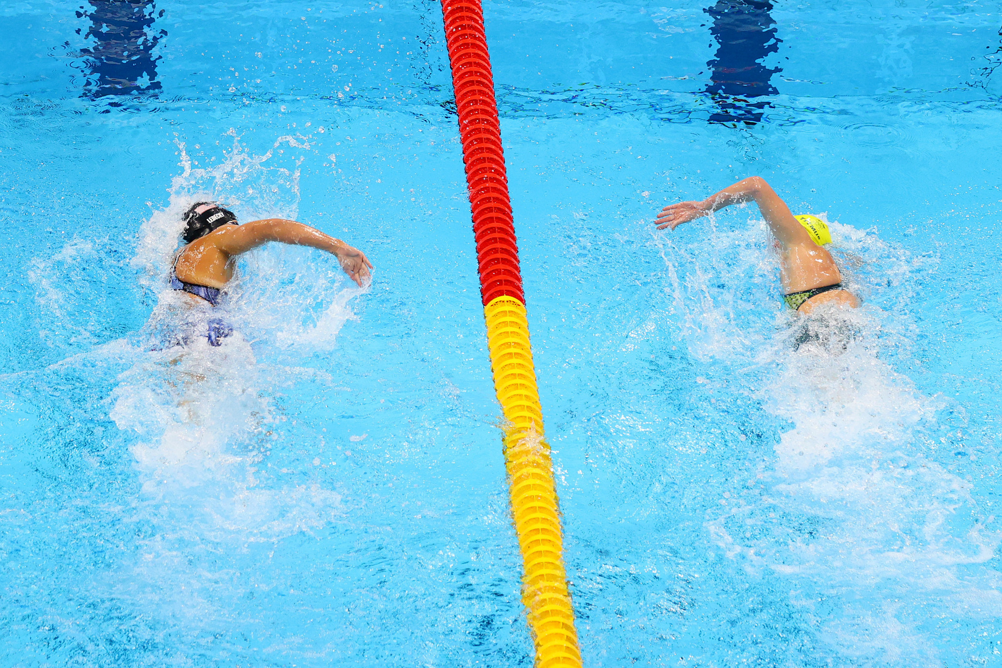 Australia's Ariarne Titmus, right, came from behind to snatch victory from five-time Olympic champion Katie Ledecky of the United States in a women's 400m freestyle final for the ages ©Getty Images
