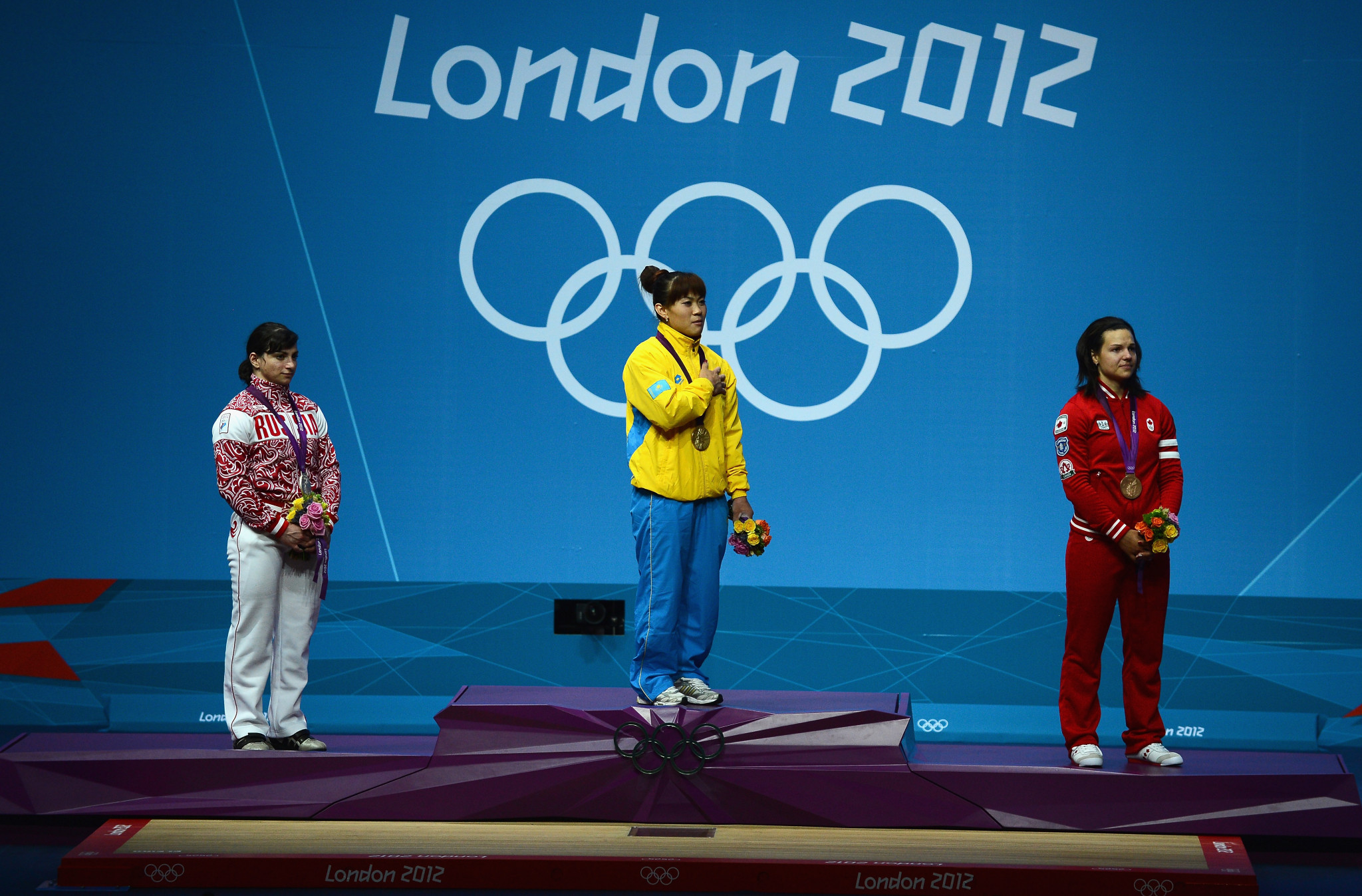Christine Girard, right, was given a bronze medal at London 2012, but that was eventually upgraded to gold ©Getty Images