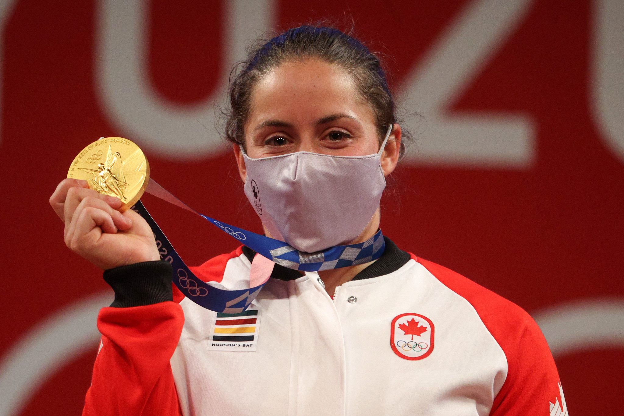 She should be a police officer now - instead Charron is an Olympic weightlifting champion