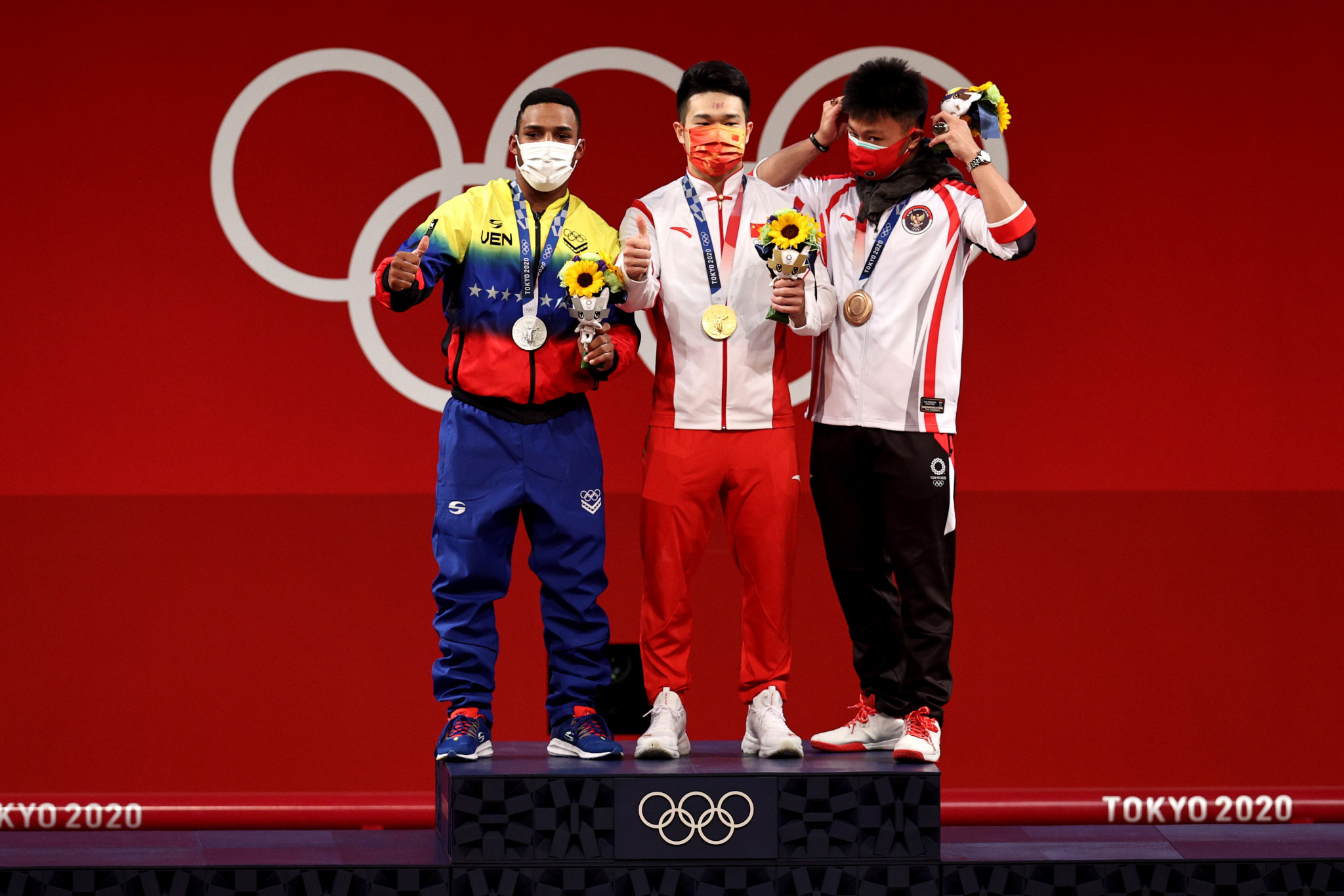 The podium for the men's 73kg category - from left Julio Mayora, Shi Zhiyong and Rahmat Erwin Abdullah ©Getty Images