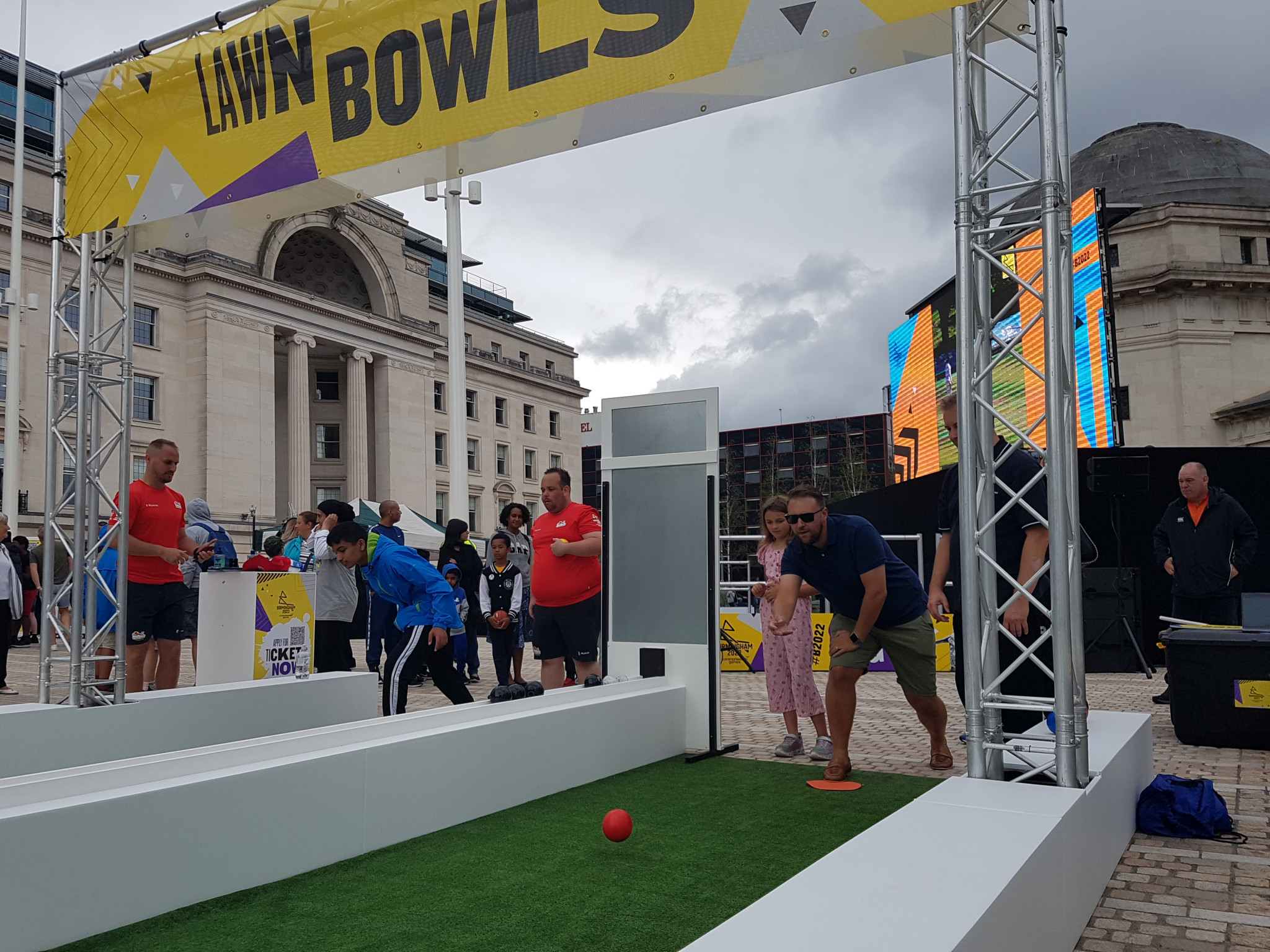 Lawn bowls was popular with the public, with participants attempting to roll balls into holes ©ITG